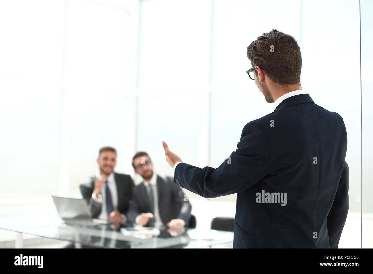 successful lawyer inviting to his office - Stock Image