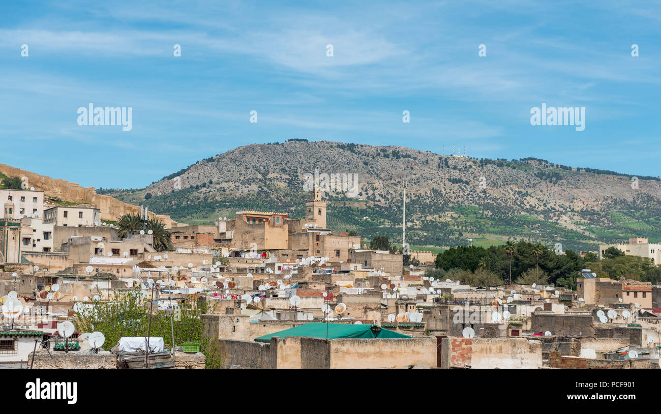 City view of Fez, behind green hills, Fes, Morocco - Stock Image