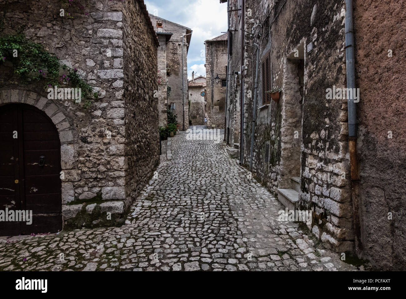Stone timeworn walls of an old town. - Stock Image