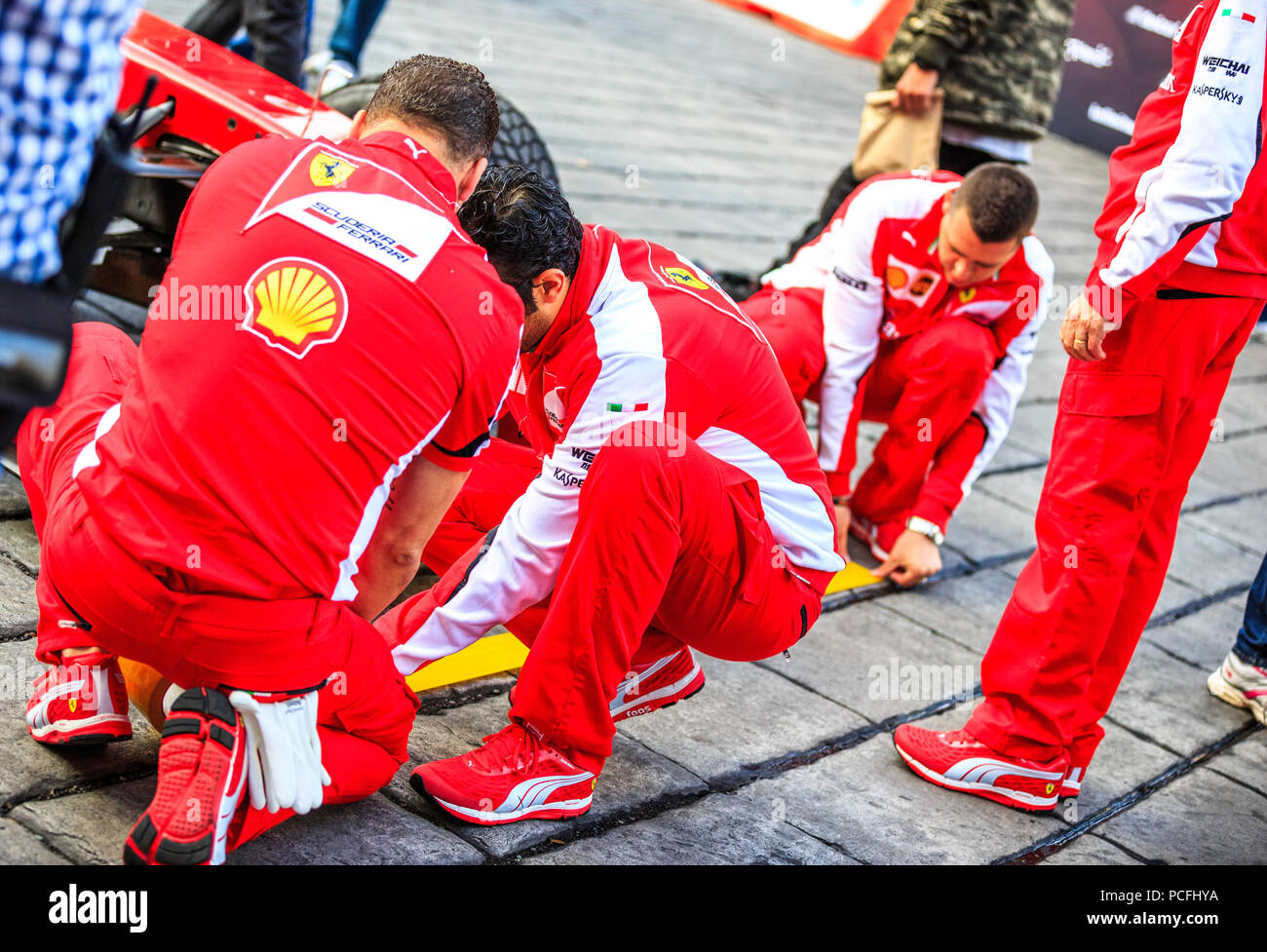 Mexico City, Mexico - July 08, 2015: Ferrari Crew marking the Pit Stop Lines. At the Scuderia Ferrari Street Demo By Telcel - Infinitum. - Stock Image