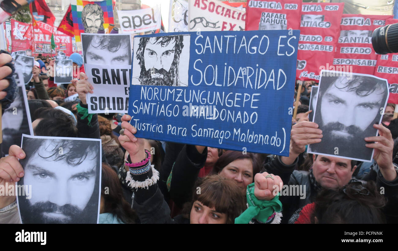 Ciudad De Buenos Aires, Argentina. 02nd Aug, 2018. People participate in a demonstration to support the family of the young Argentine deceased Santiago Maldonado, in Buenos Aires, Argentina, 01 August 2018. The family of the young Argentinean deceased Santiago Maldonado today led a demonstration of thousands of people in Buenos Aires to return to ask for 'justice and truth' one year after his disappearance in the course of a Mapuche protest in the south of the country that was dissolved by police. Credit: Javier Caamano/EFE/Alamy Live News - Stock Image