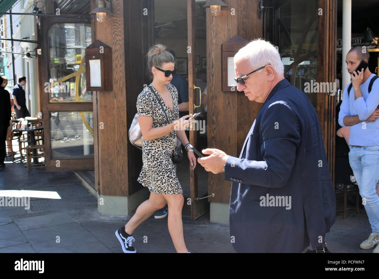 London. UK.August 2nd 2018. Ofcom report warns that smartphone addiction increasing rapidly. Londoners check their smartphones on average every 12 minutes. People in Soho and the West End check their smartphones. © Brian Minkoff / Alamy Live News - Stock Image