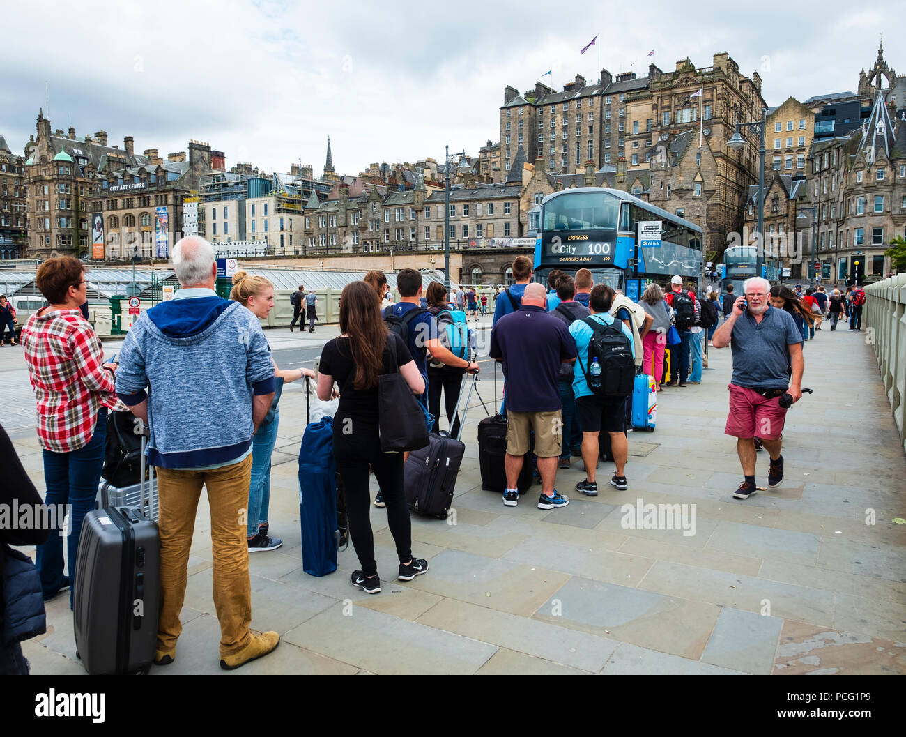 Edinburgh, Scotland, UK. 2nd August, 2018. At the start of the Edinburgh Festival many tourists are arriving in the city , however, many people are also leaving the city and heading to the airport, as this long queue for the airport Express 100 bus shows. Credit: Iain Masterton/Alamy Live News - Stock Image