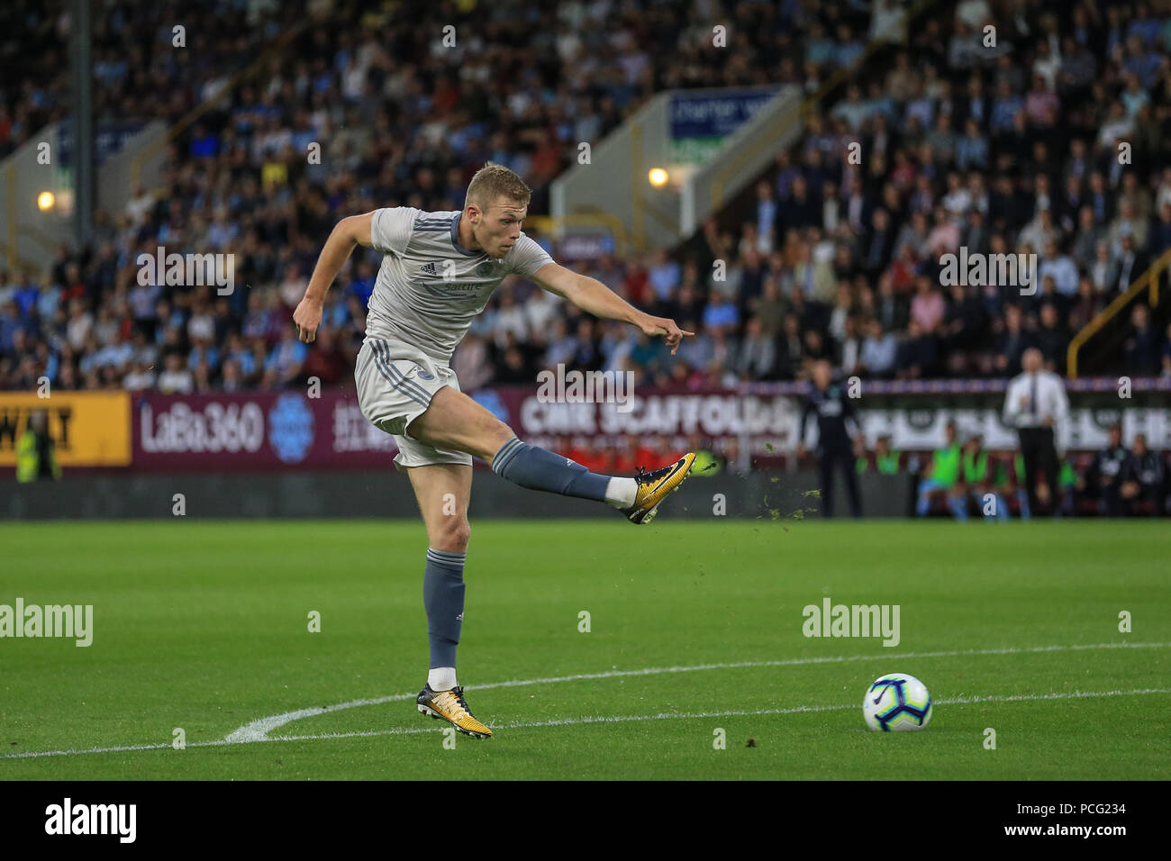 Turf Moor, Burnley, UK. 2nd August 2018, Turf Moor, Burnley, England; UAFA Europa League Qualifying Second Round Burnley v Aberdeen; Sam Cosgrove of Aberdeen shoots on goal but miss hits the ball Credit: News Images /Alamy Live News - Stock Image