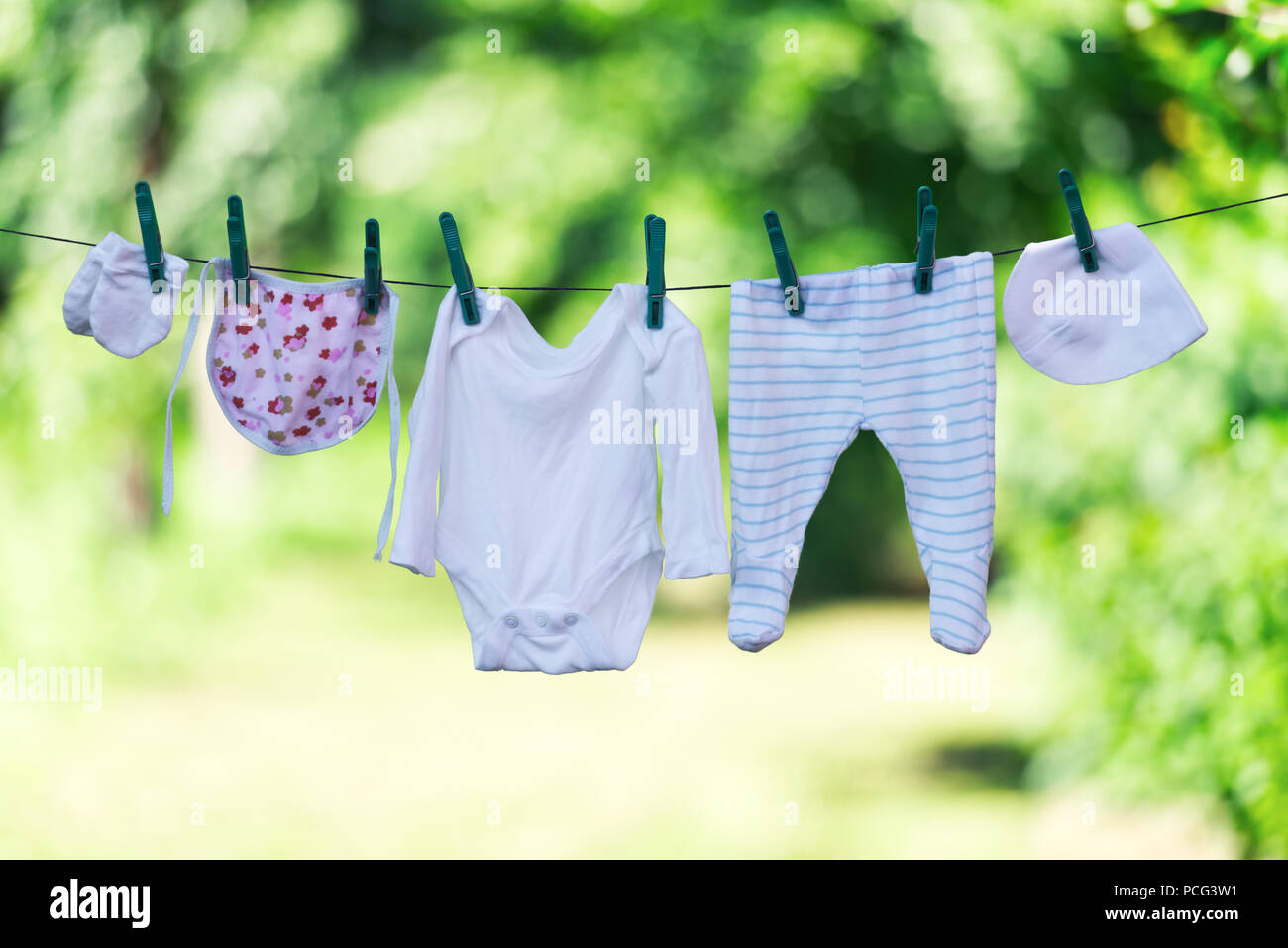 Baby Clothes And Clothesline High Resolution Stock Photography and