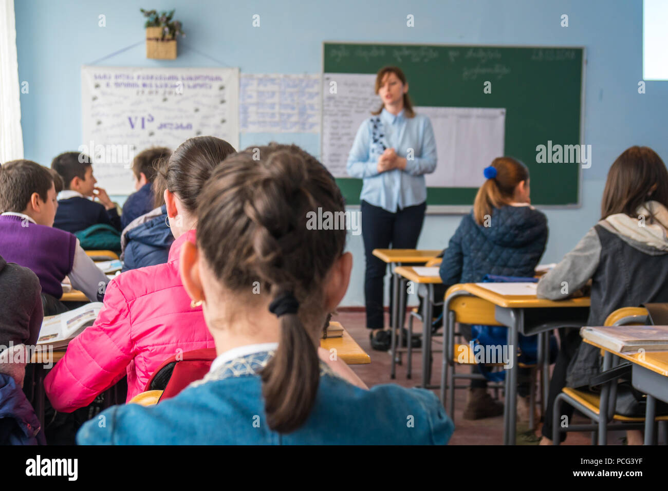 school children are participating actively in class. Education. - Stock Image
