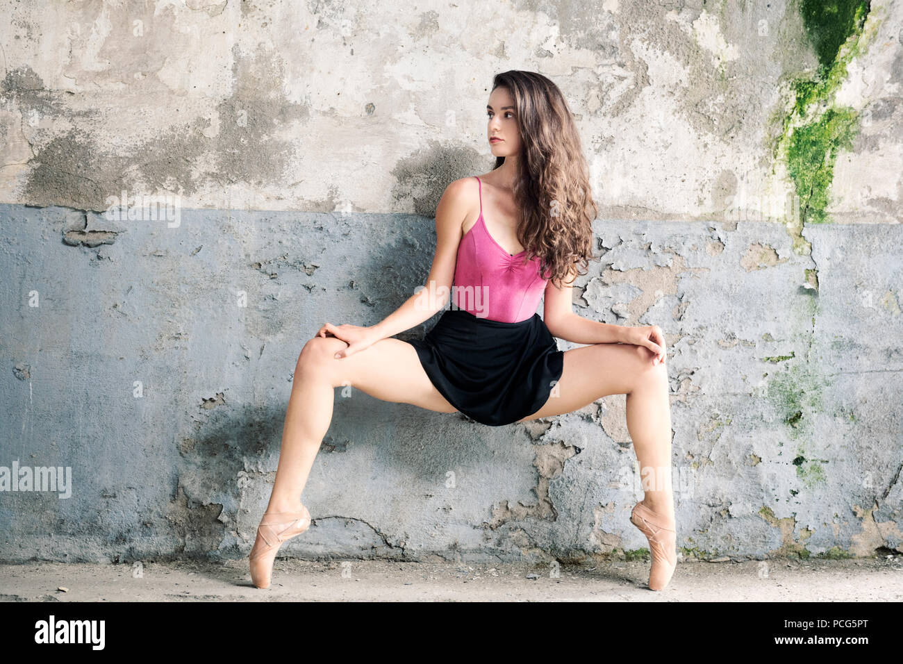 Ballerina On Pointe Looking Away In Abandoned Building Stock Photo Alamy