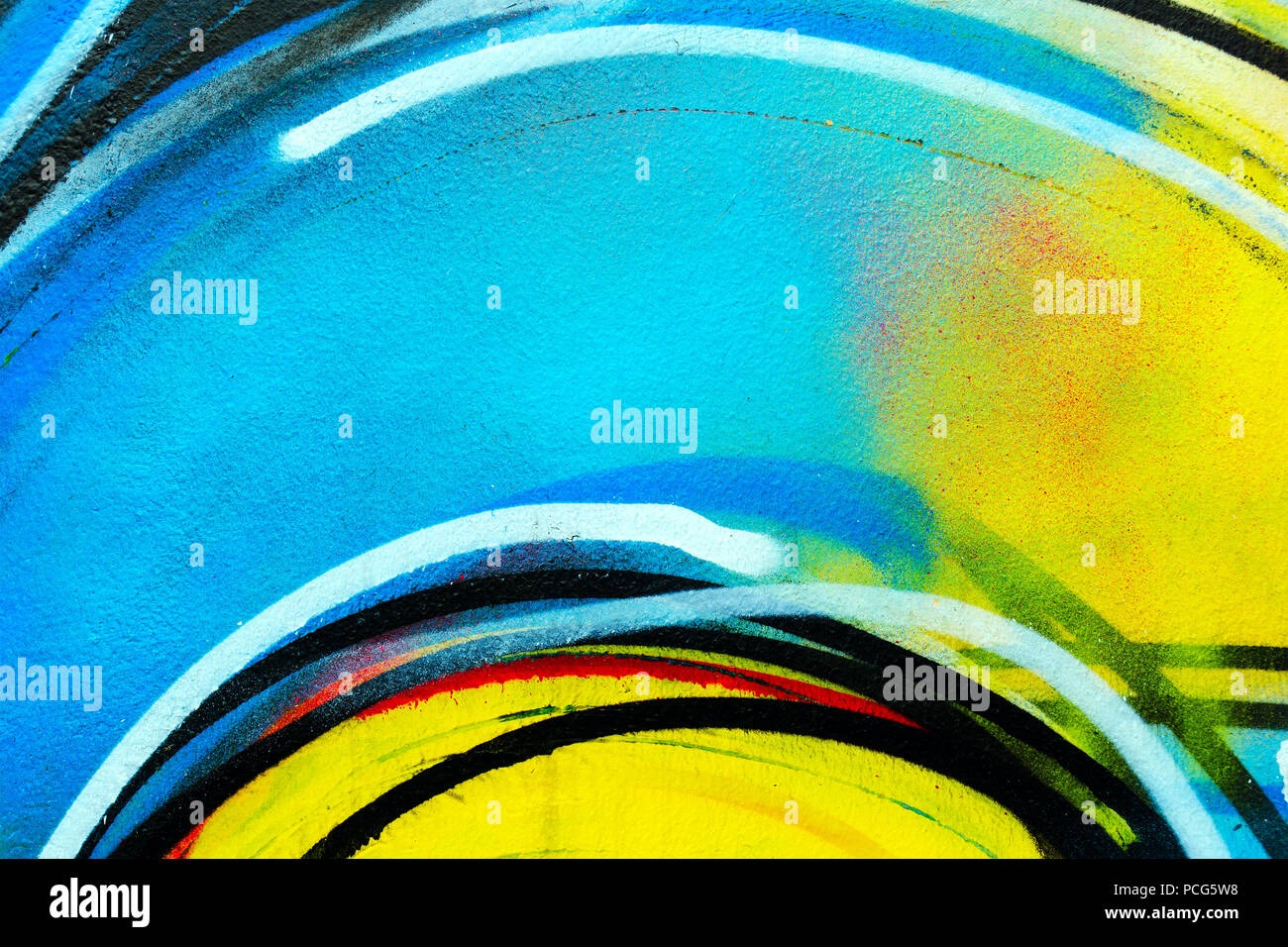 Urban wall -  bright colorful backdrop. Graffiti closeup. Abstract street art spray paint background. Wide photo for web site slider. - Stock Image