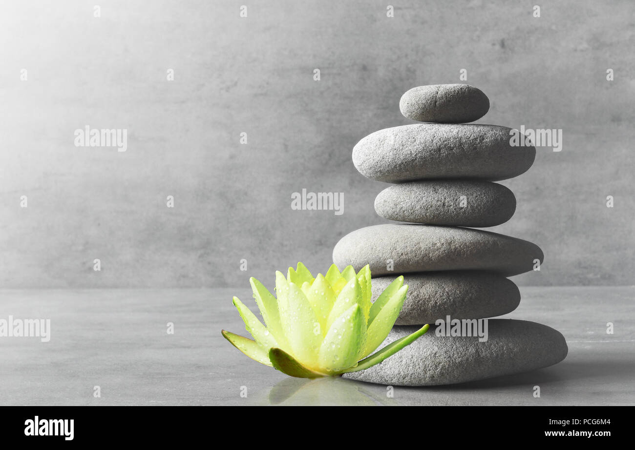 Stones balance and white flower lotus. Zen and spa concept. - Stock Image