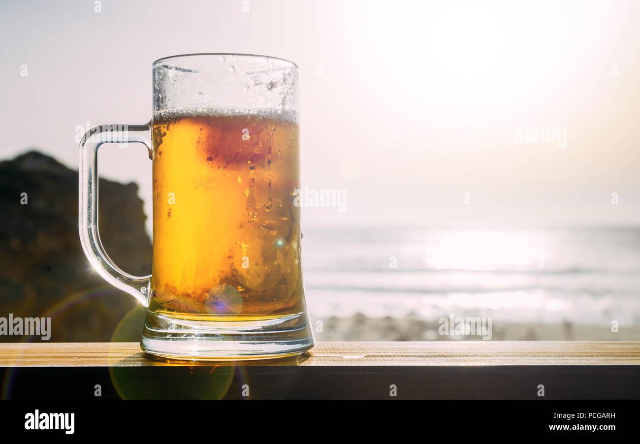 Cold draft beer at beach - Stock Image