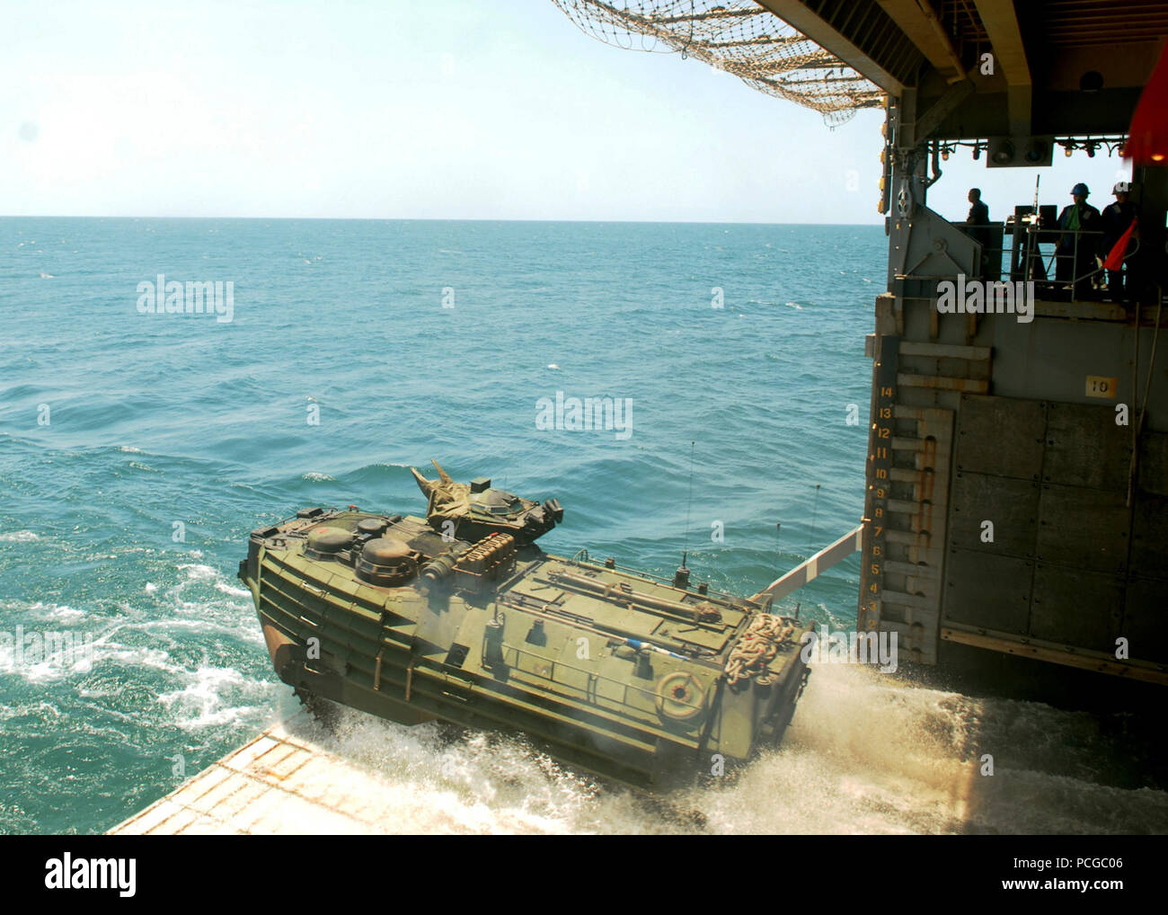 SEA (Oct. 16, 2009) An amphibious assault vehicle from to the 11th Marine Expeditionary Unit (11th MEU) debarks the well deck of the amphibious dock landing ship USS Rushmore (LSD 47) and heads ashore to Indonesia to support Marine Exercise (MAREX) 09. MAREX is a multilateral training exercise designed to enhance interoperability and communication between the U.S. and Indonesia militaries. Rushmore is part of the Bonhomme Richard Amphibious Ready Group transiting the U.S. 7th Fleet area of responsibility. Stock Photo