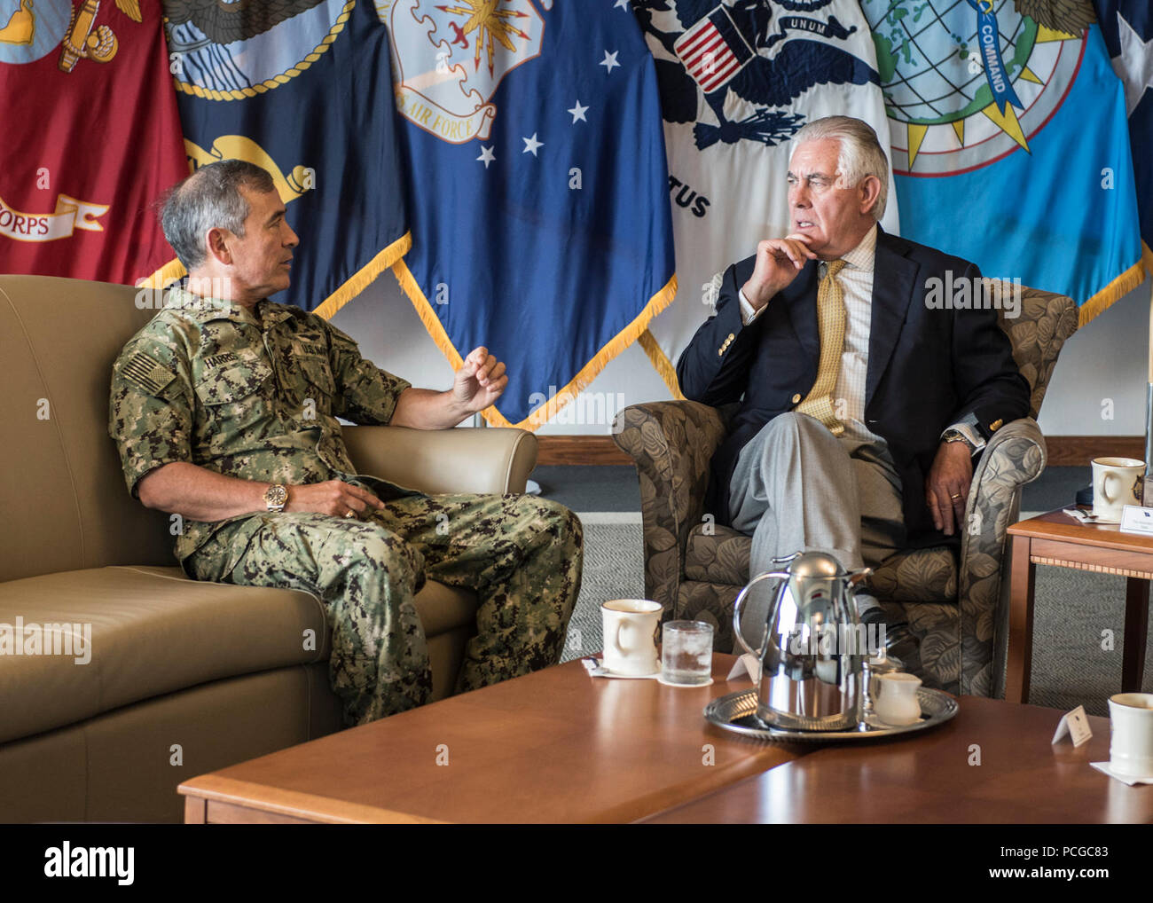 CAMP H.M. SMITH, Hawaii (August 4, 2017)— Adm. Harry Harris, Commander of U.S. Pacific Command (PACOM), has a conversation with U.S. Secretary of State Rex Tillerson at PACOM Headquarters. Secretary Tillerson is traveling to Manila, Bangkok, and Kuala Lumpur to meet with his counterparts and discuss a range of issues including the denuclearization of the Korean Peninsula, maritime security, and counterterrorism.  Secretary Tillerson's travel reaffirms the Administration's commitment to further broaden and enhance U.S. economic and security interests in the Indo-Asia-Pacific region. Stock Photo