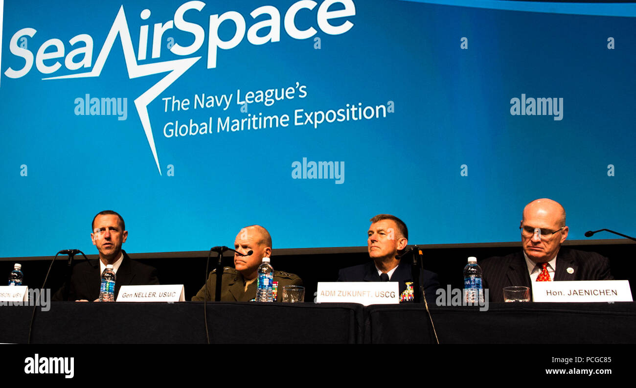 "NATIONAL HARBOR, Md. (May 16, 2016) Chief of Naval Operations Adm. John Richardson, left, Commandant of the U.S. Marine Corps Gen. Robert Neller, Commandant of the U.S. Coast Guard Adm. Paul K. Zukunft, and  Paul N. Jaenichen, administrator of the U.S. Maritime Administration, speak during their ""Service Chief's Update"" panel discussion at the Sea-Air-Space Exposition. The annual event brings together key military decision makers, the U.S. defense industrial base and private-sector U.S. companies for an innovative and educational maritime based event. Stock Photo"