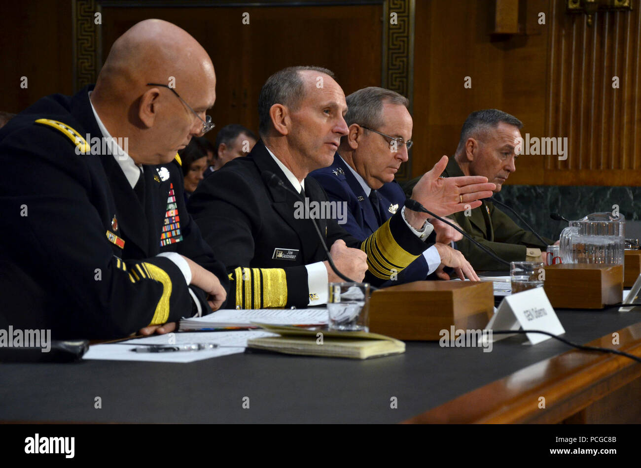 WASHINGTON (Jan. 28, 2015) Chief of Naval Operations (CNO) Adm. Jonathan Greenert, center left, testifies before the Senate Armed Services Committee. Greenert, along with other service chiefs, Chief of Staff of the Army Gen. Raymond T. Odierno, left; Chief of Staff of the Air Force Gen. Mark A. Welsh III, center right; and Commandant of the Marine Corps Gen. Joseph F. Dunford, Jr., testified on the impact of the Budget Control Act of 2011 and sequestration on national security. Stock Photo