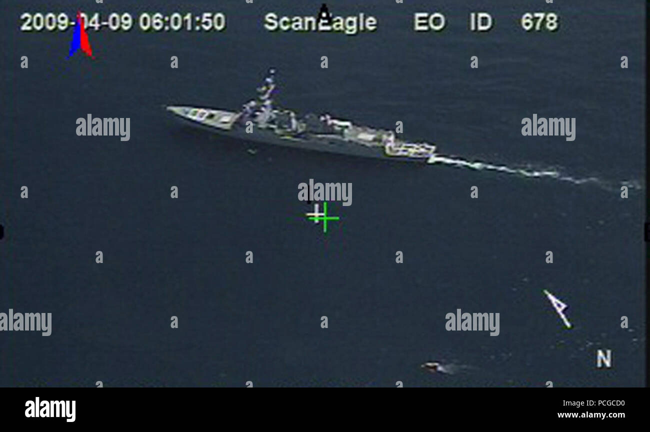 OCEAN (April 9, 2009) In a still frame from video released by the U.S. Navy taken by the Scan Eagle unmanned aerial vehicle, the guided-missile destroyer USS Bainbridge (DDG 96) is underway near a 28-foot lifeboat from the U.S.-flagged container ship Maersk Alabama Thursday, April 9, 2009 in the Indian Ocean. Stock Photo