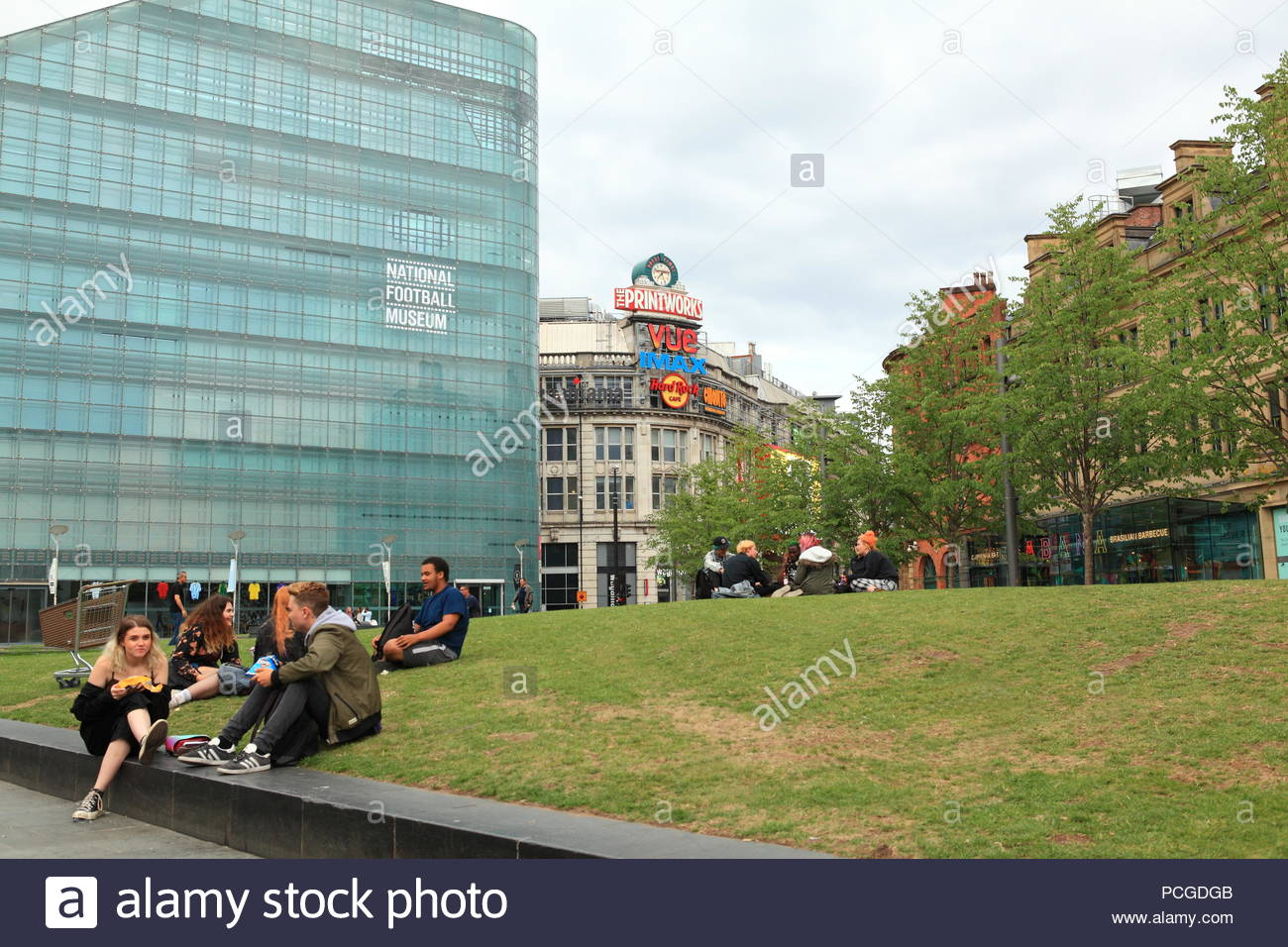 City life around the Printworks at Exchange Square Manchester UK. Summer August 2018 Evening Stock Photo