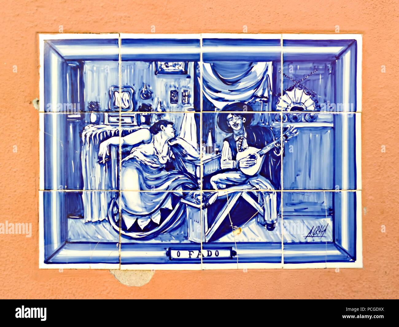 Lisbon. Tiles (Azulajos showing Fado singers on a building in Alfama. - Stock Image