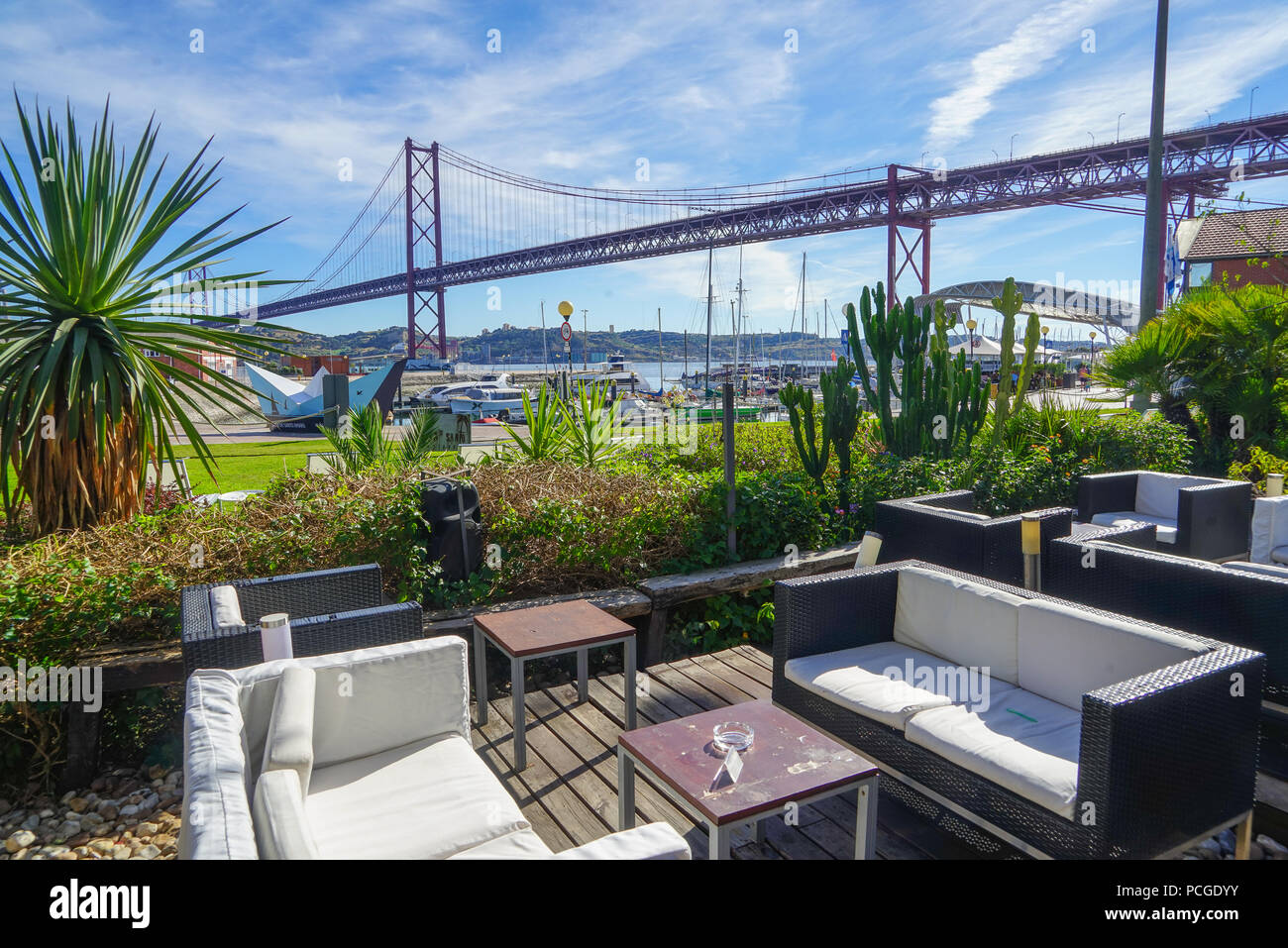 Lisbon. Harbour cafe close to Ponte 25 do Abril - Stock Image