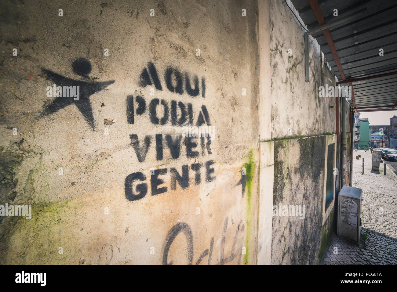 Lisbon. Artist graffity against gentrification saying 'People could live here.' - Stock Image