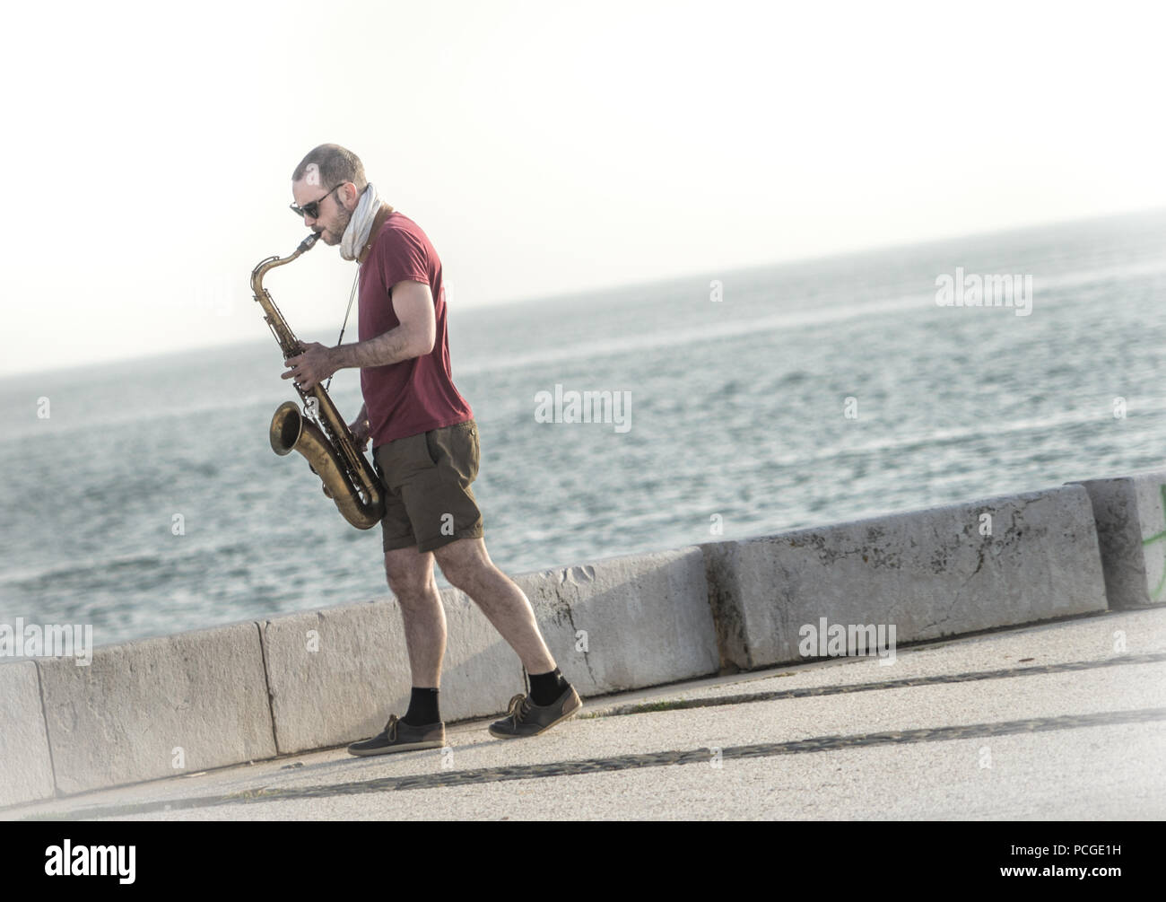 Lisbon. Saxophone player by the Targus river. - Stock Image