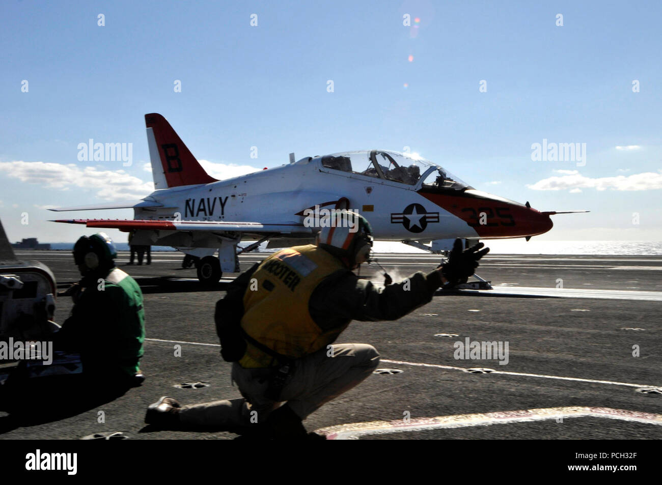 OCEAN (Nov. 5, 2011) A T-45C Goshawk training aircraft assigned to the Eagles of Training Squadron (VT) 7 launches from the aircraft carrier USS Ronald Reagan (CVN 76). Ronald Reagan is conducting operations supporting Naval Air Training Command carrier qualifications. - Stock Image
