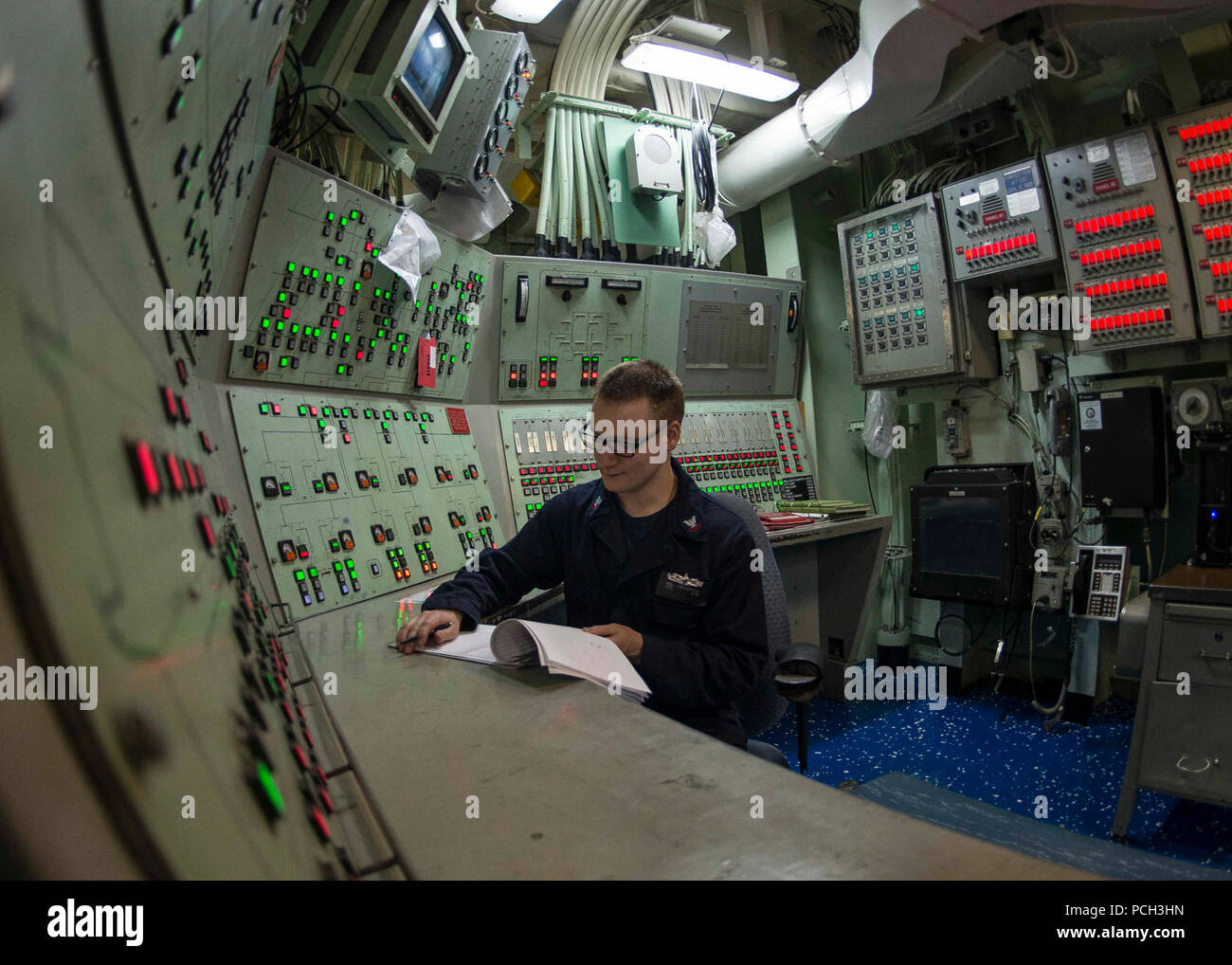 U.S. 5TH FLEET AREA OF OPERATIONS (May 12, 2018) Damage Controlman 2nd Class Ross Fergerson stands watch as the damage control central watch supervisor aboard the Wasp-class amphibious assault ship USS Iwo Jima (LHD 7). Iwo Jima is homeported in Mayport, Fla., and is on deployment to the U.S. 5th Fleet area of operations in support of maritime security operations to reassure allies and partners, and preserve the freedom of navigation and the free flow of commerce in the region. Stock Photo