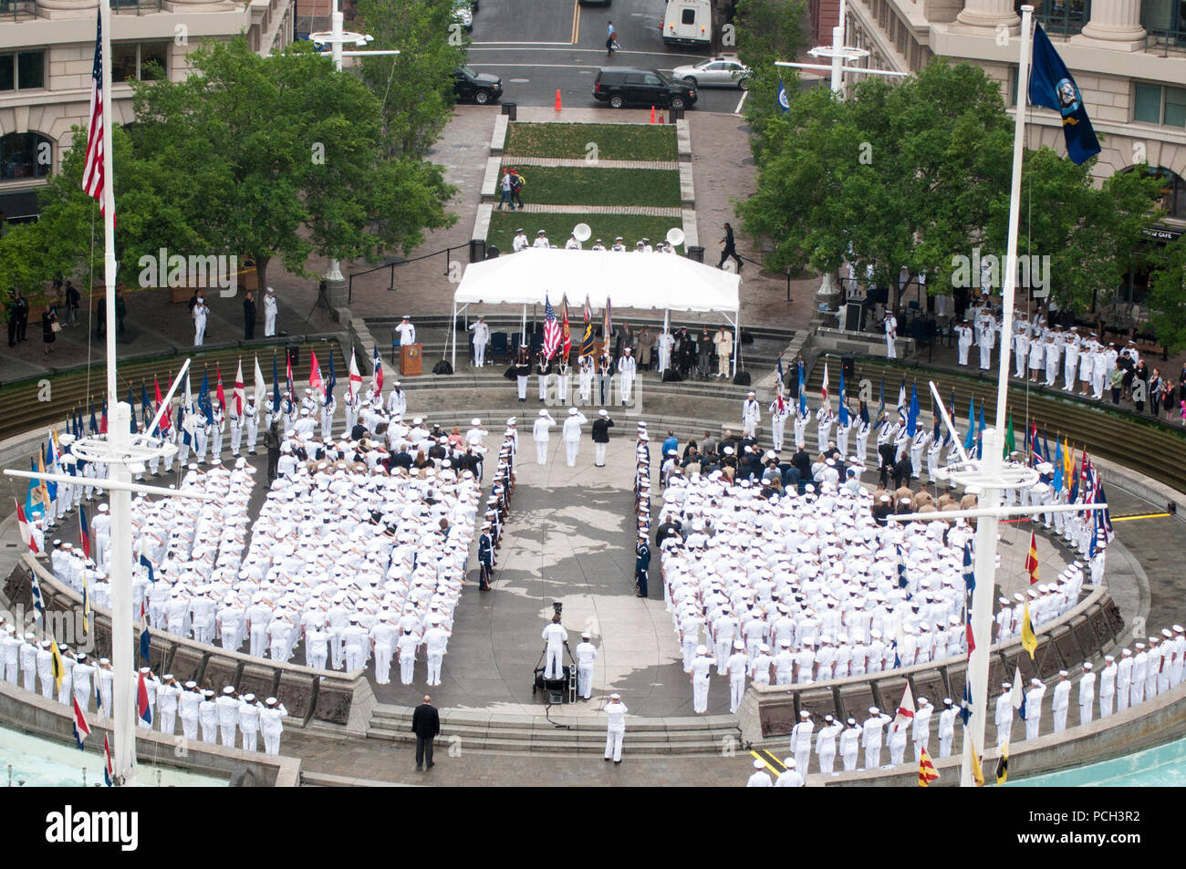 WASHINGTON (June 4, 2015) A sea of white uniforms greets visitors to the Navy Memorial in Washington, D.C. as Sailors pause to celebrate the 73rd anniversary of the Battle of Midway. The celebration held host to Marines, Navy, and Coast Guard service members, Midway veterans and a crowd of onlookers. The Battle of Midway is considered by many to be the turning point of World War II in the Pacific theater and one of the most well-known and revered victories in U.S. naval history. - Stock Image