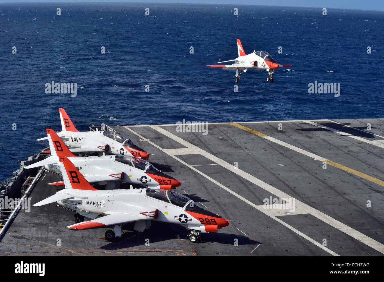 ATLANTIC OCEAN (Feb. 4, 2016) A T-45C Goshawk assigned to Carrier Training Wing (CTW) 2 lands on the flight deck of the aircraft carrier USS Dwight D. Eisenhower (CVN 69). Dwight D. Eisenhower is currently underway preparing for the upcoming Board of Inspection and Survey (INSURV) and conducting carrier qualifications. - Stock Image