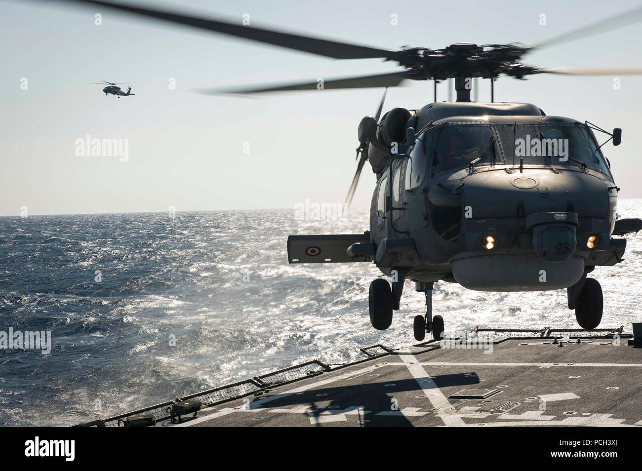 MEDITERRANEAN SEA (March 28, 2016) A Turkish Navy S-70B Seahawk lands aboard USS Porter (DDG 78). Porter, an Arleigh Burke-class guided-missile destroyer, forward-deployed to Rota, Spain, is conducting a routine patrol in the U.S. 6th Fleet area of operations in support of U.S. national security interests in Europe. Stock Photo