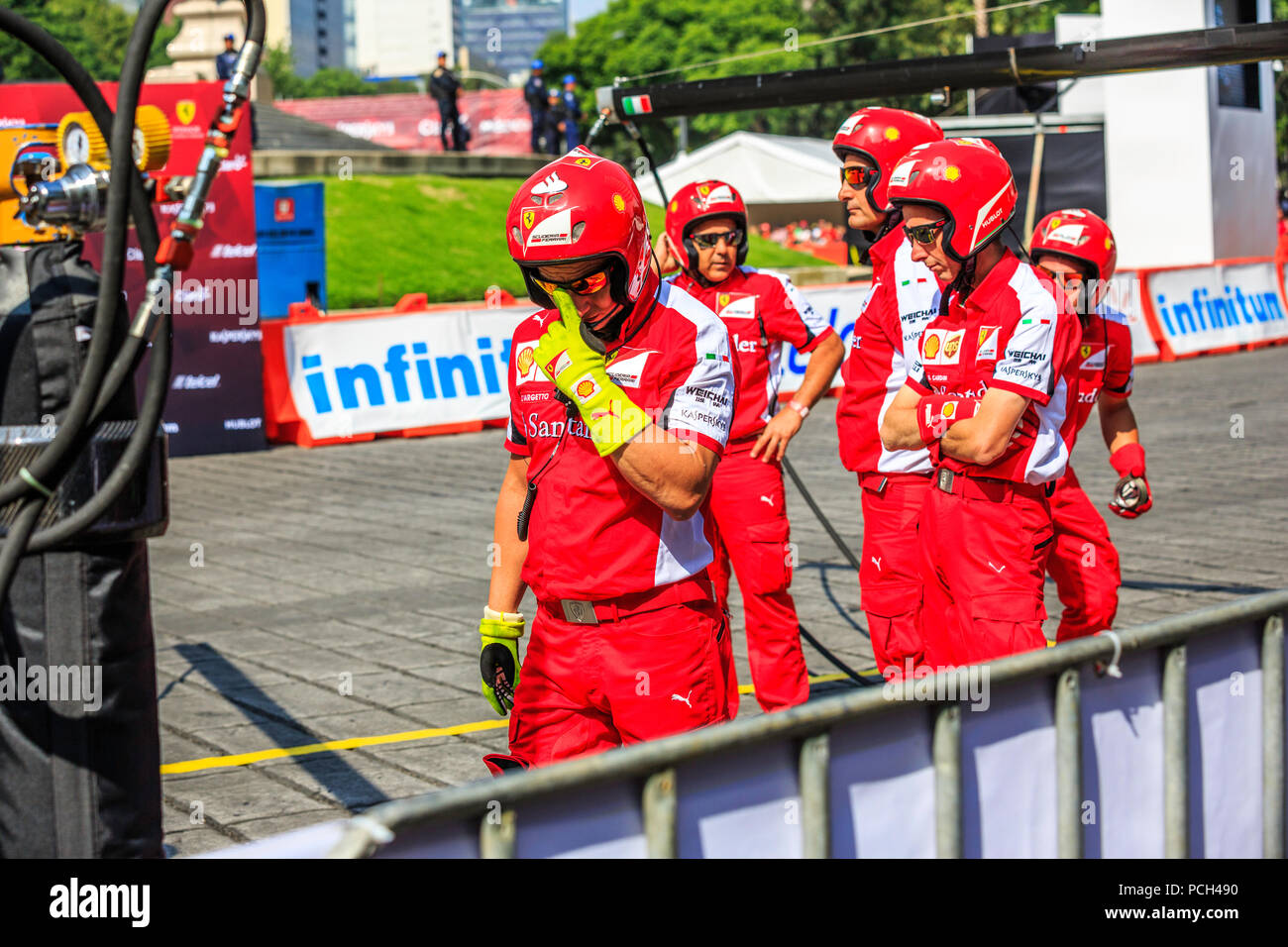 Mexico City, Mexico - July 08, 2015: Pit Crew waiting to Esteban Gutiérrez on its Ferrari F1 F60 Car to arrive to the Pit Stop for the Wheel Change. At the Scuderia Ferrari Street Demo By Telcel - Infinitum. - Stock Image