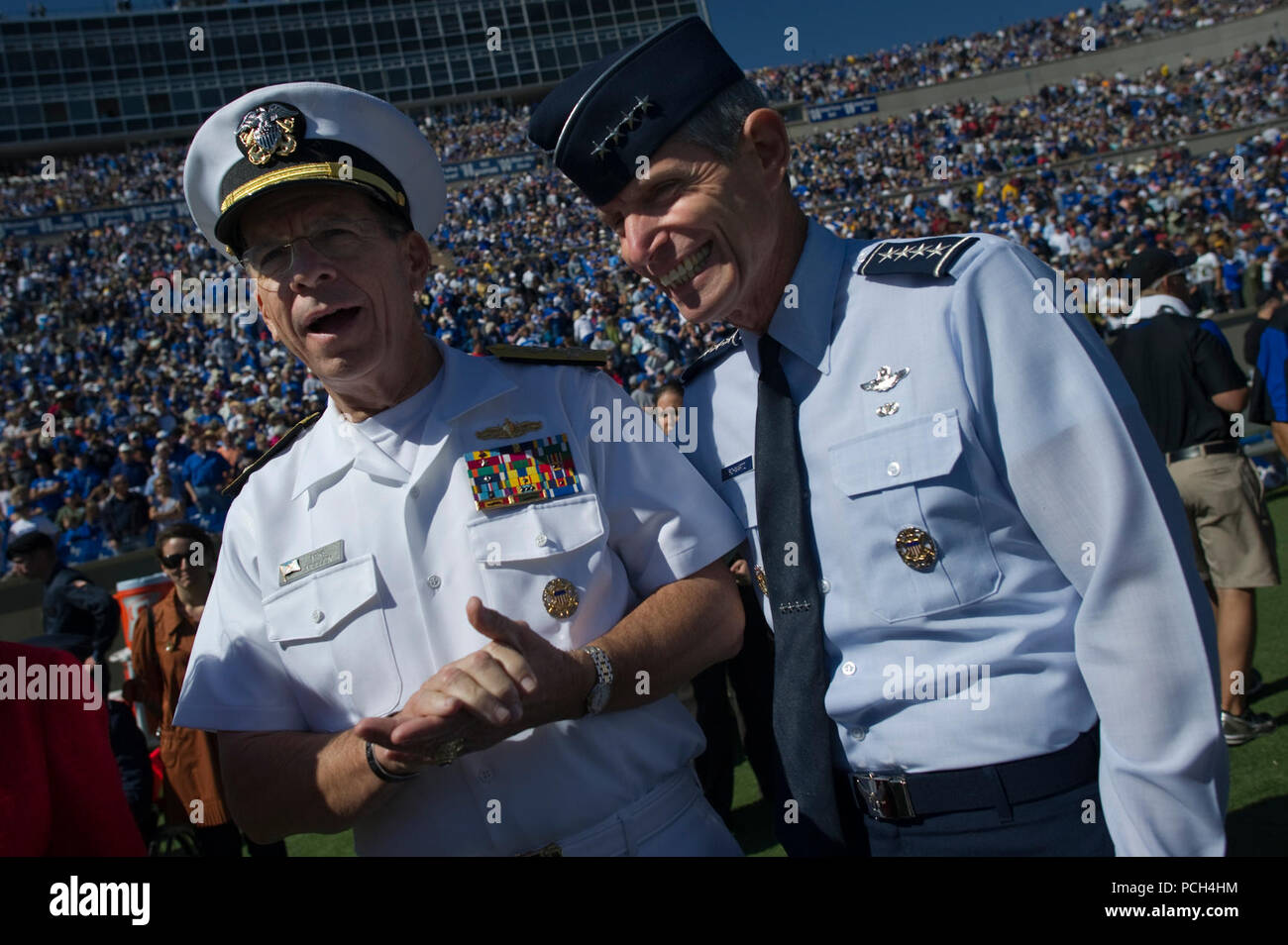 Chairman of the Joint Chiefs of Staff Adm. Mike Mullen, left, and U.S. Air Force Gen. Norton A. Schwartz, chief of staff, U.S. Air Force, meet on the Falcon Stadium field prior to kickoff of the U.S. Air Force Academy Falcons versus the U.S Naval Academy Midshipmen football game in Colorado Springs, Colo. The Falcons defeated the Midshipmen 14-6. Stock Photo