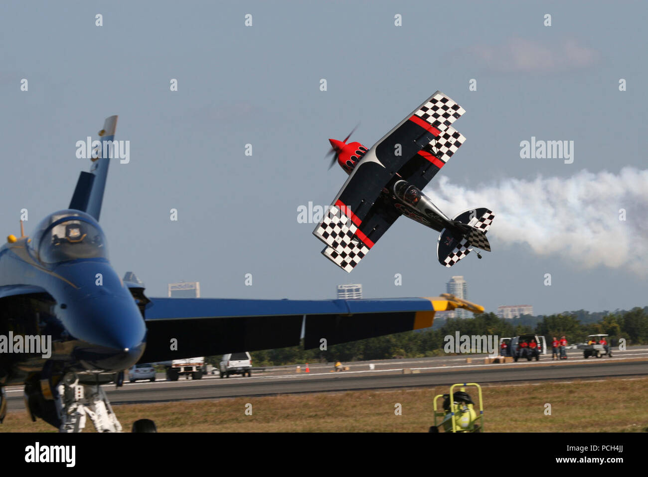 Skip Stewart performs acrobatic maneuvers in his Pitts S-2S bi-plane, named Prometheus, during the 2010 NAS Jax Air Show. The U.S Navy flight demonstration squadron, the Blue Angels, highlighted the show, which included more than 20 other acts with various military static displays. A record crowd of 277,000 people attended the annual two-day show. Stock Photo