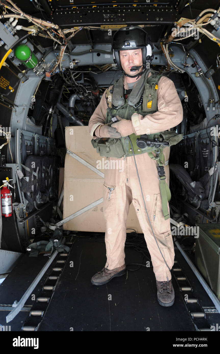 Marine Corps Sgt. Camaron Depue, from Marine Medium Tiltrotor Squadron 162, stands in the aft of an MV-22 Osprey as the aircraft prepares to take off from the U.S. Naval Station Guantanamo Bay airfield. The aircraft, scheduled to fly supplies for Haiti to USS Bataan, is here in support of Operation Unified Response. Stock Photo