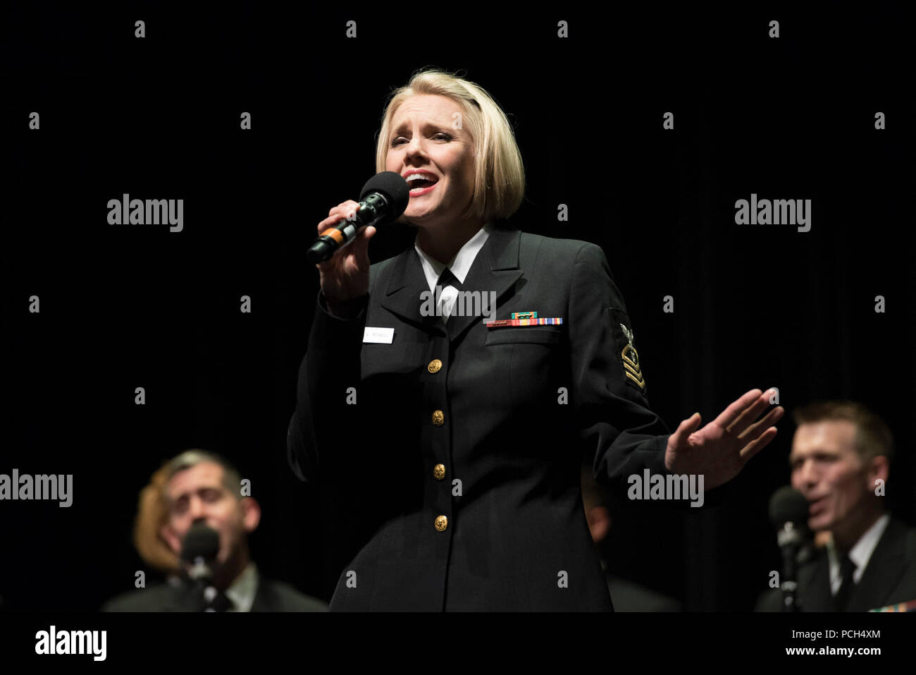 AKRON, Ohio (April 19 2017) Chief Musician Beth Revell sings a solo during a performance at the University of Akron. The Sea Chanters are on a 21-day tour of the midwestern United States connecting communities across the United States to their Navy. - Stock Image