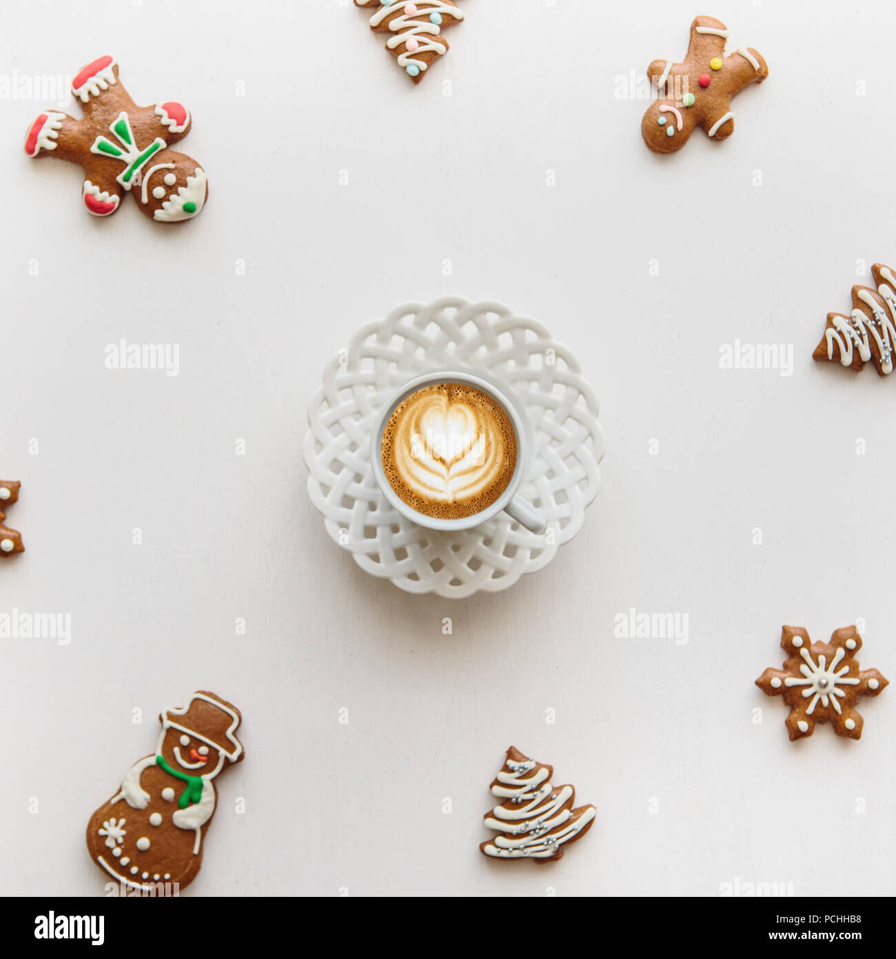 A cup of freshly flavored cappuccino coffee. Near the scenery in the Christmas or New Year's style. Christmas concept. - Stock Image
