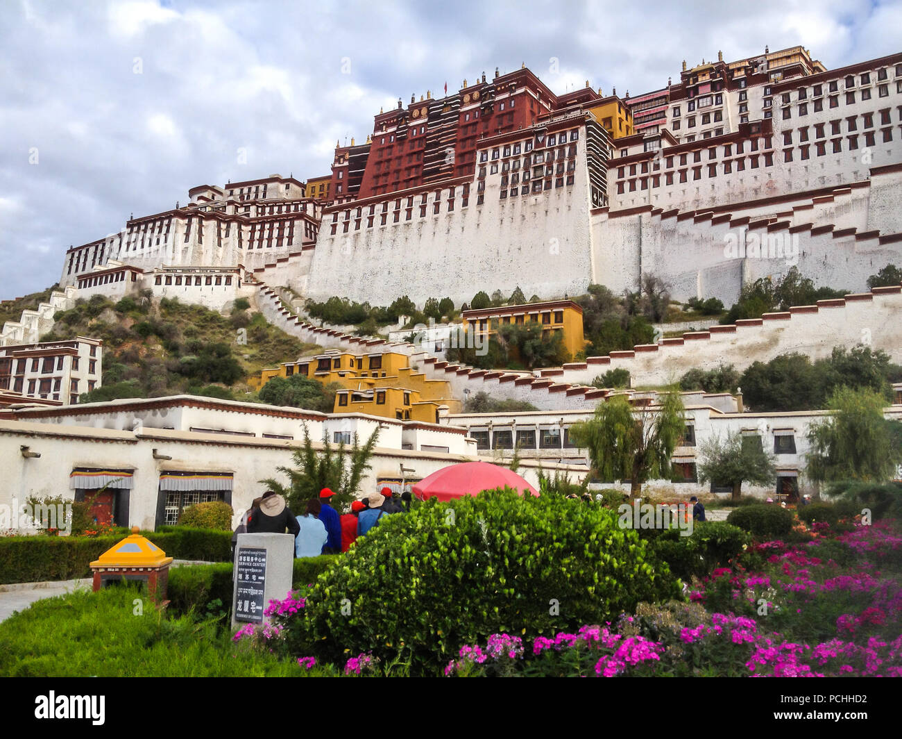 Potala Palace Front View with Garden in Lhasa, Tibet Autonomous Region. Former Dalai Lama residence, now is a museum and World Heritage Site. - Stock Image