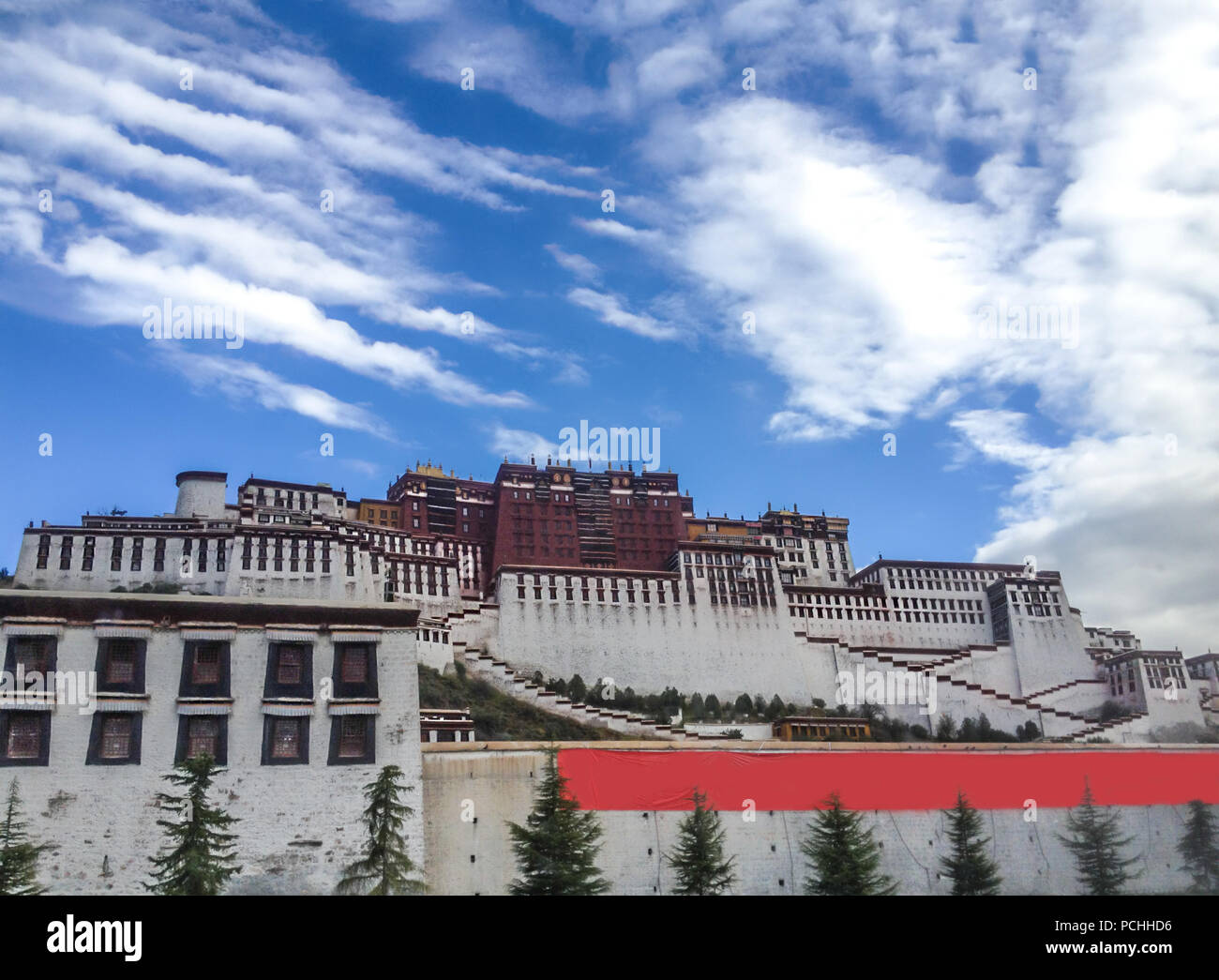 Potala Palace in Lhasa day view from town square with blue sky background, Tibet Autonomous Region. Former Dalai Lama residence, now is a museum and W Stock Photo