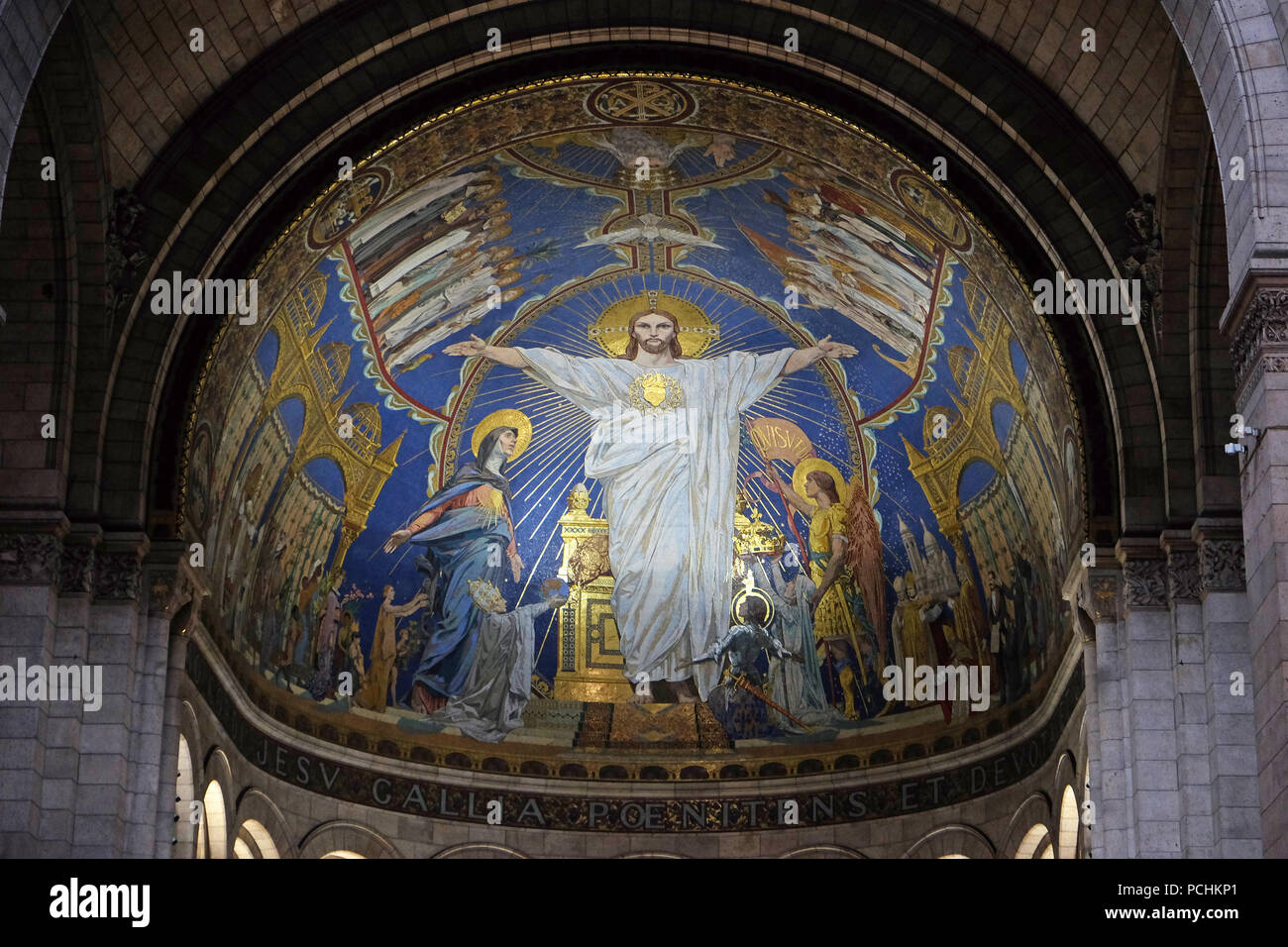 Christ in Majesty is surrounded by the Virgin Mary, Joan of Arc and St. Michael, mosaic by Luc-Olivier Merson, Basilica of the Sacred Heart of Jesus i Stock Photo