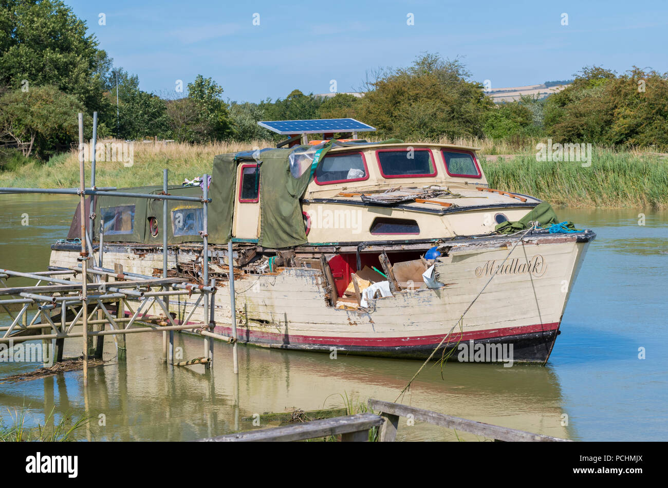 neglected-old-wooden-boat-with-hole-and-