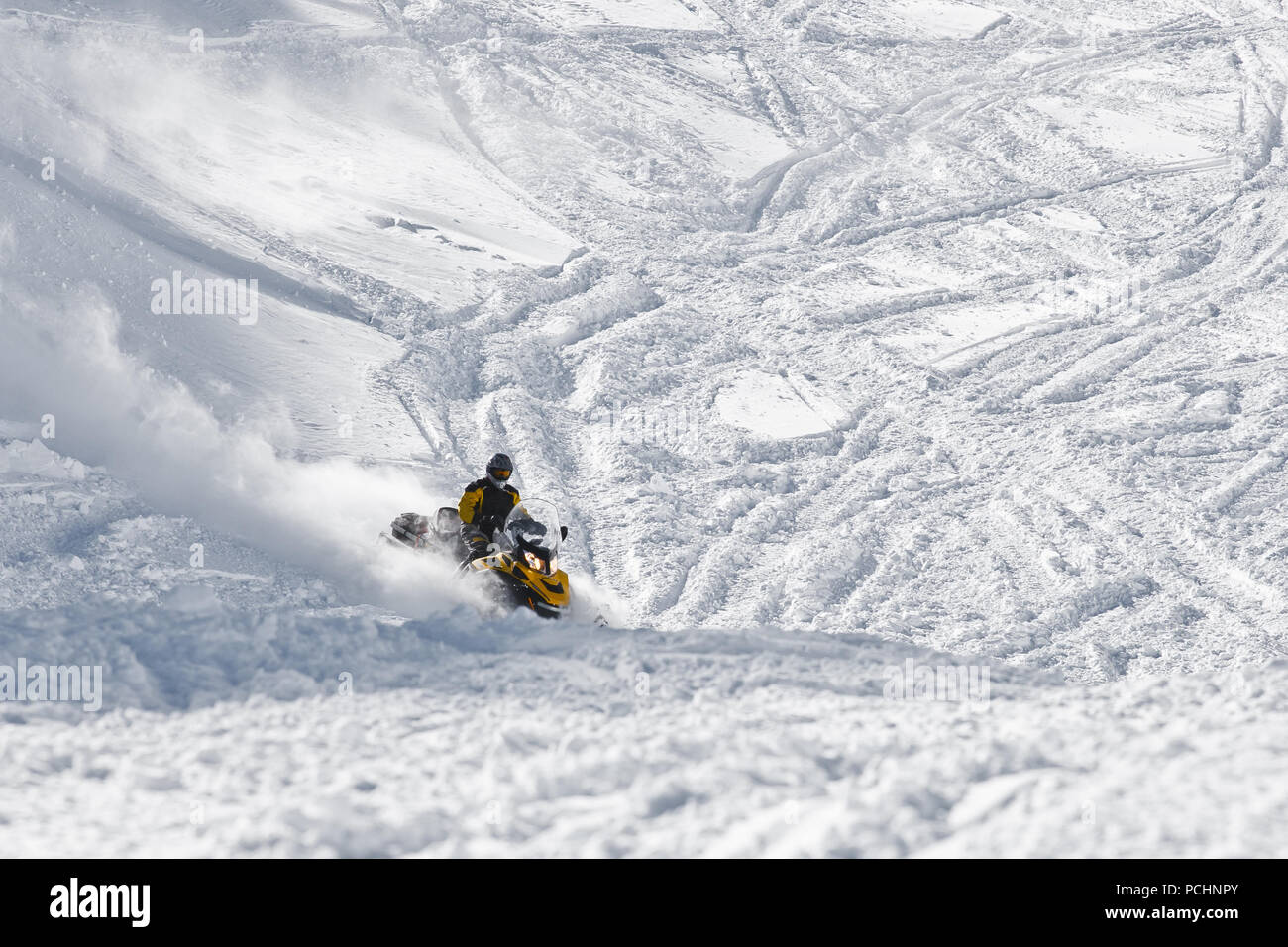 Racer snowmobile on a snowy mountainside. State Nature Reserve in Adygea, Russia, February 2, 2012. - Stock Image