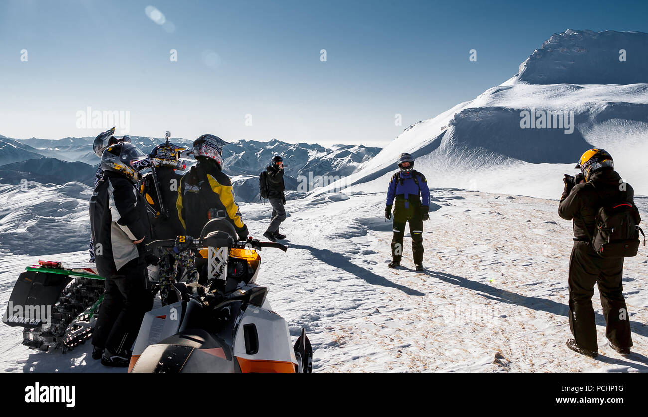 Snowmobile riders are photographed on a snow-covered plateau of Lago-Naki in Adygea, Russia, February 2, 2012. - Stock Image