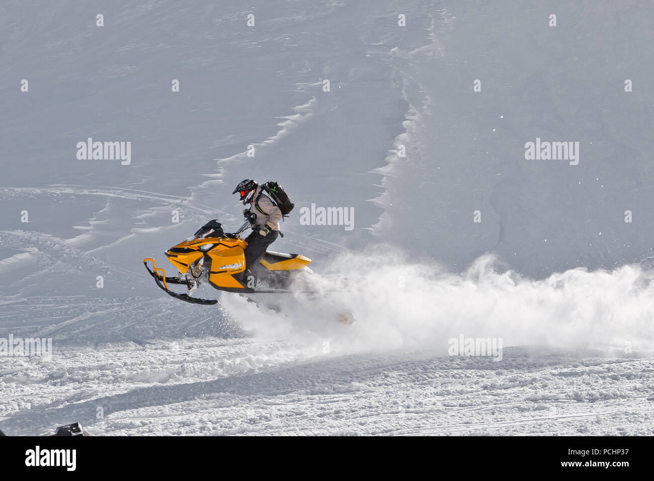 The rider bounces on a snowmobile on a plateau of Lago-Naki in Adygea, Russia February 2, 2012. - Stock Image