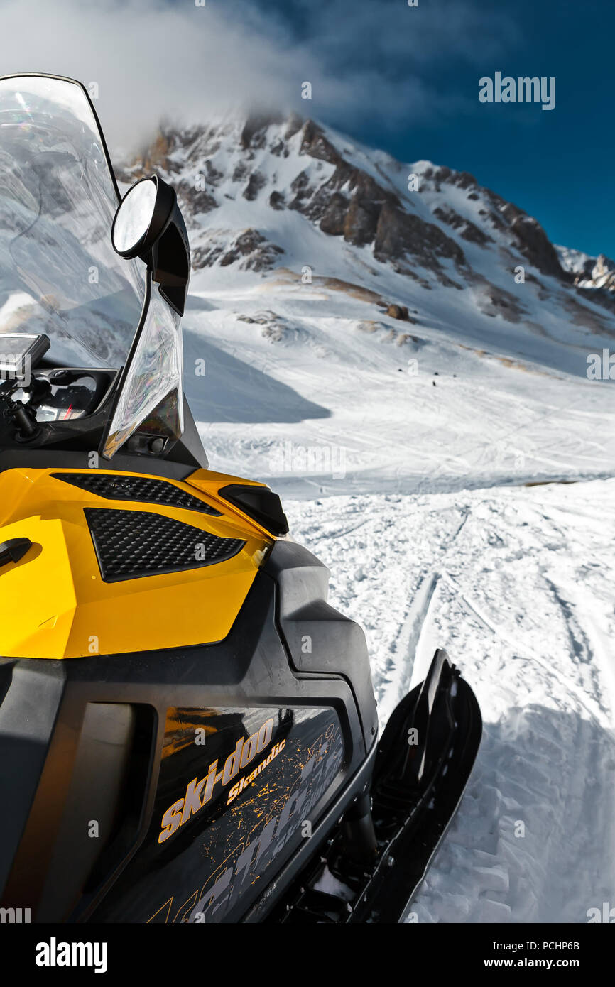 Snowmobile 'BRP Skandiс' on the background of mountains on the plateau of Lago-Naki in Adygea, Russia on February 3, 2012. - Stock Image