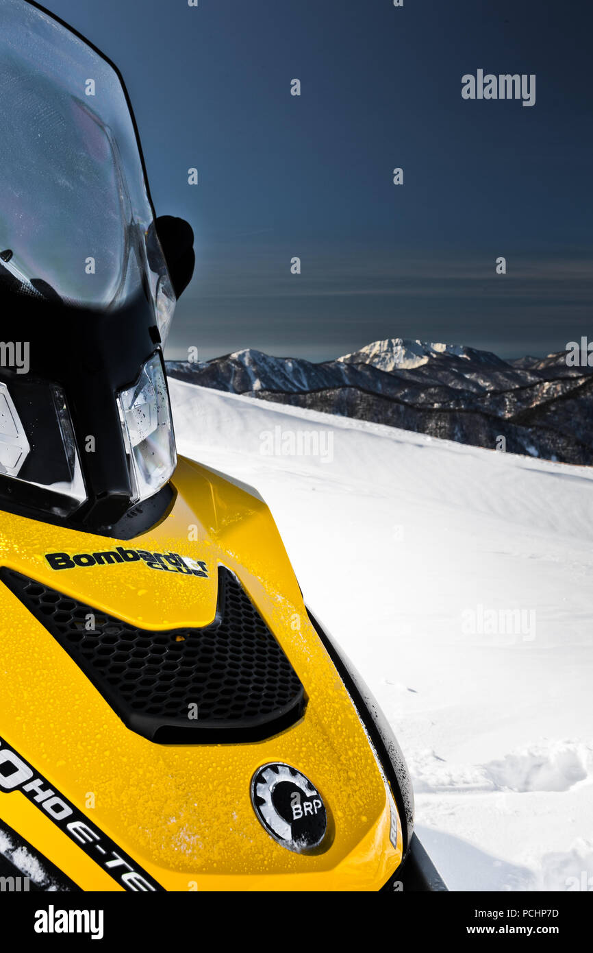 Snowmobile 'BRP Skandiс' on the background of mountains on the plateau of Lago-Naki in Adygea, Russia on 4 February 2012. - Stock Image