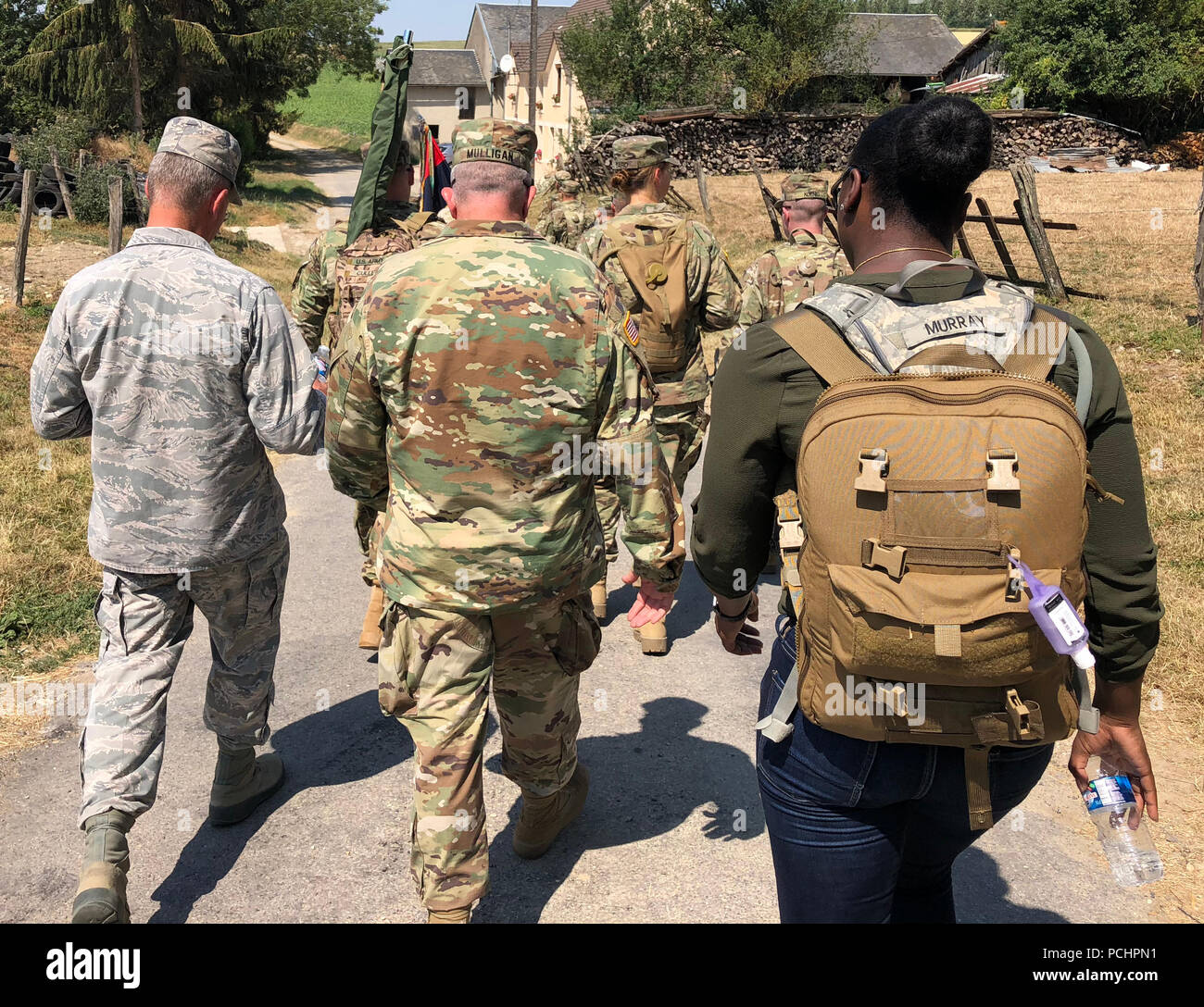 Major General Anthony German, the Adjutant General of the New York National Guard walks with Soldiers from the Division on July 27, 2018 from the town of Sergy, France where the Soldiers and Airmen participated in the Croix Rouge Farm ten mile walk. The Croix Rouge Farm battlefield tour was a 10-mile road march of historic sites of the Rainbow Division's first offensive actions from July 25-30, 1918. The assault of the division was part of the first allied attack across a 25-mile front near Soissons and Chateau-Thierry on German positions in over a year. The attack alongside French forces also - Stock Image