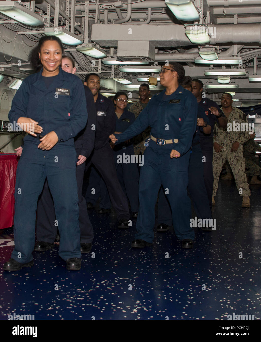 180728-N-ZK016-0046  ATLANTIC OCEAN (July 27, 2018) Sailors and Marines dance during an ice cream and cookie social on the messdecks aboard the Wasp-class amphibious assault ship USS Iwo Jima (LHD 7), July 27, 2018. Iwo Jima, homeported in Mayport, Florida, is conducting naval operations in the U.S. 6th Fleet area of operations in support of U.S. national security interests in Europe and Africa. (U.S. Navy photo by Mass Communication Specialist 3rd Class Joe J. Cardona Gonzalez/Released) Stock Photo