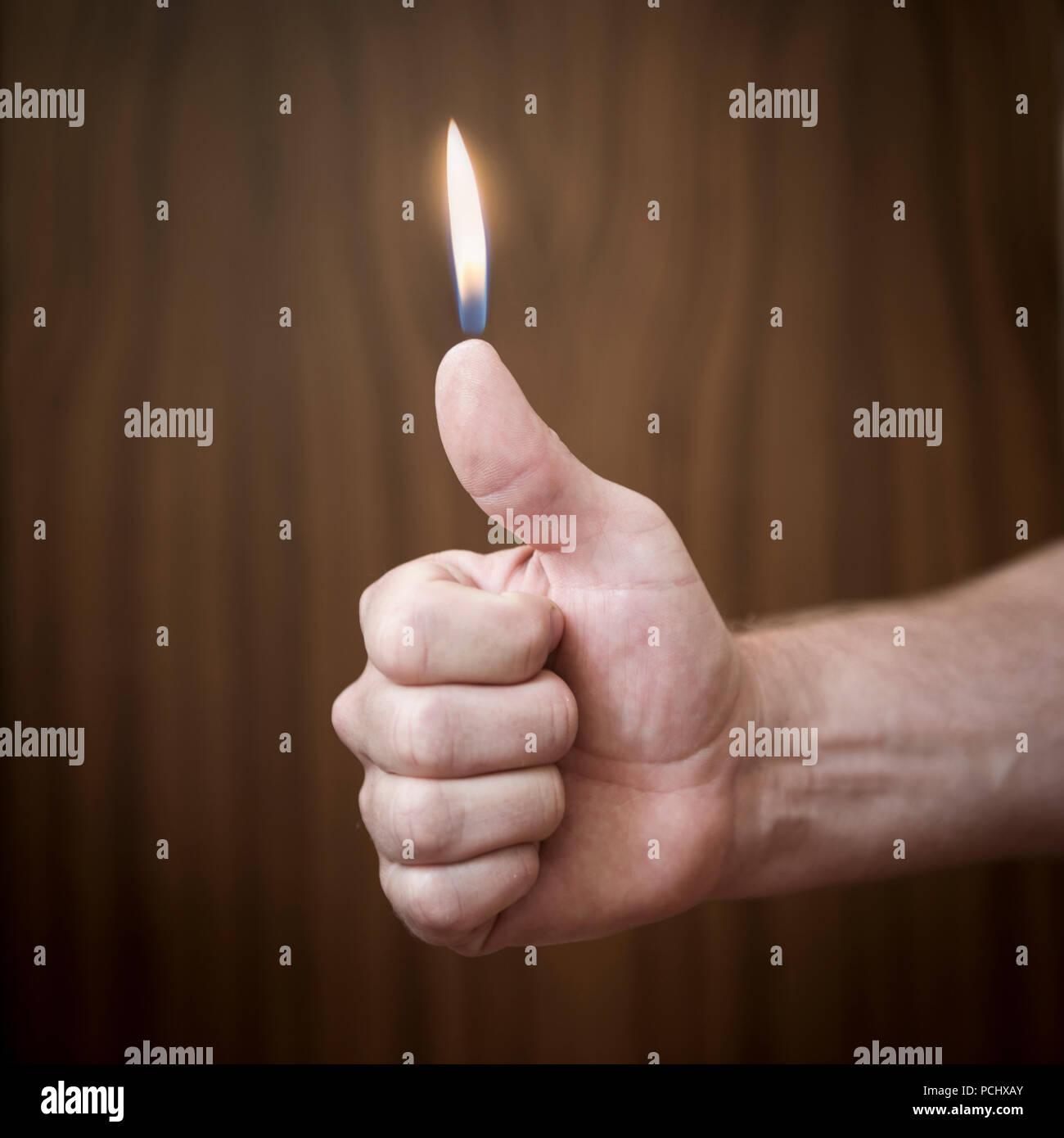 ideas,flame,human thumb,wick,burning - Stock Image