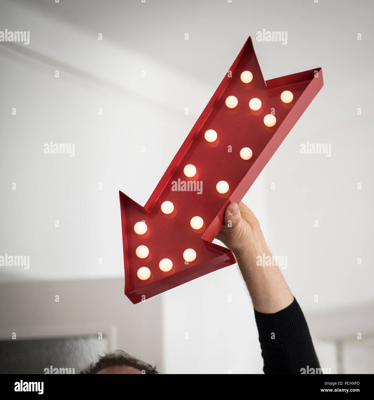 arrow,showing,down - Stock Image