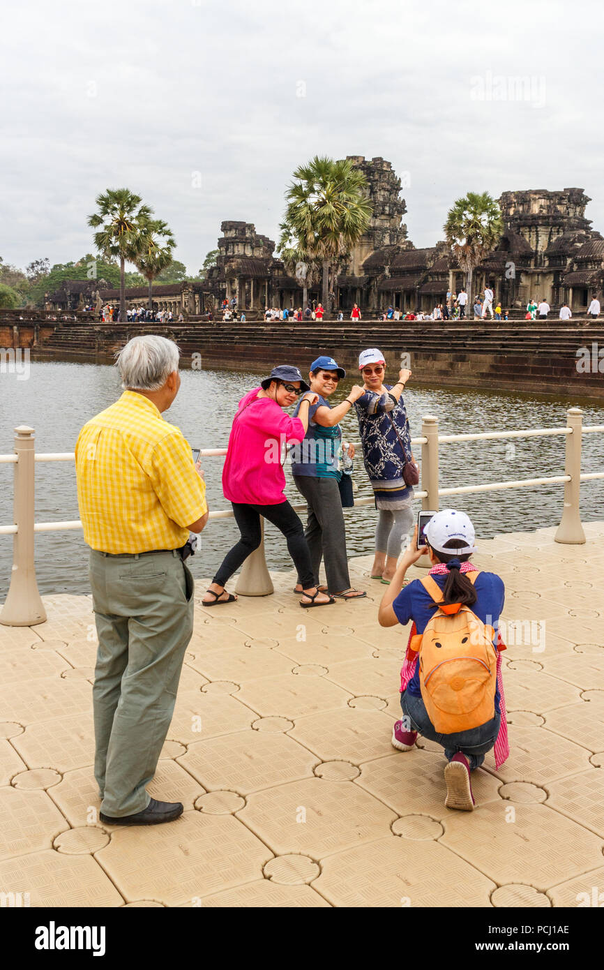 Angkor Wat, Cambodia - 11th January 2018: Chinese tourists pose for photos, Huge numbers visit the temple complae. Stock Photo