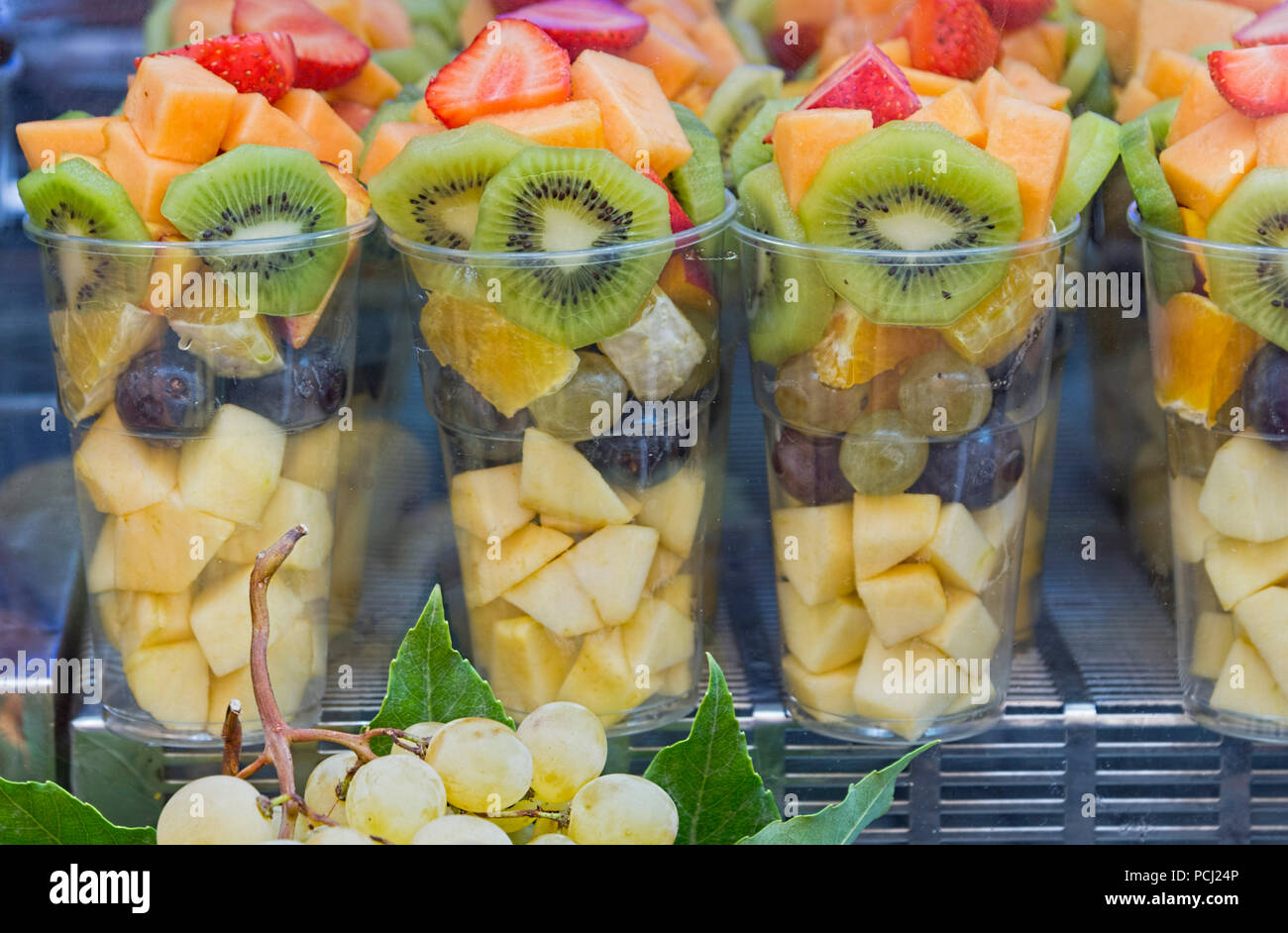 Fruit salad being sold in plastic cups Rome Italy - Stock Image